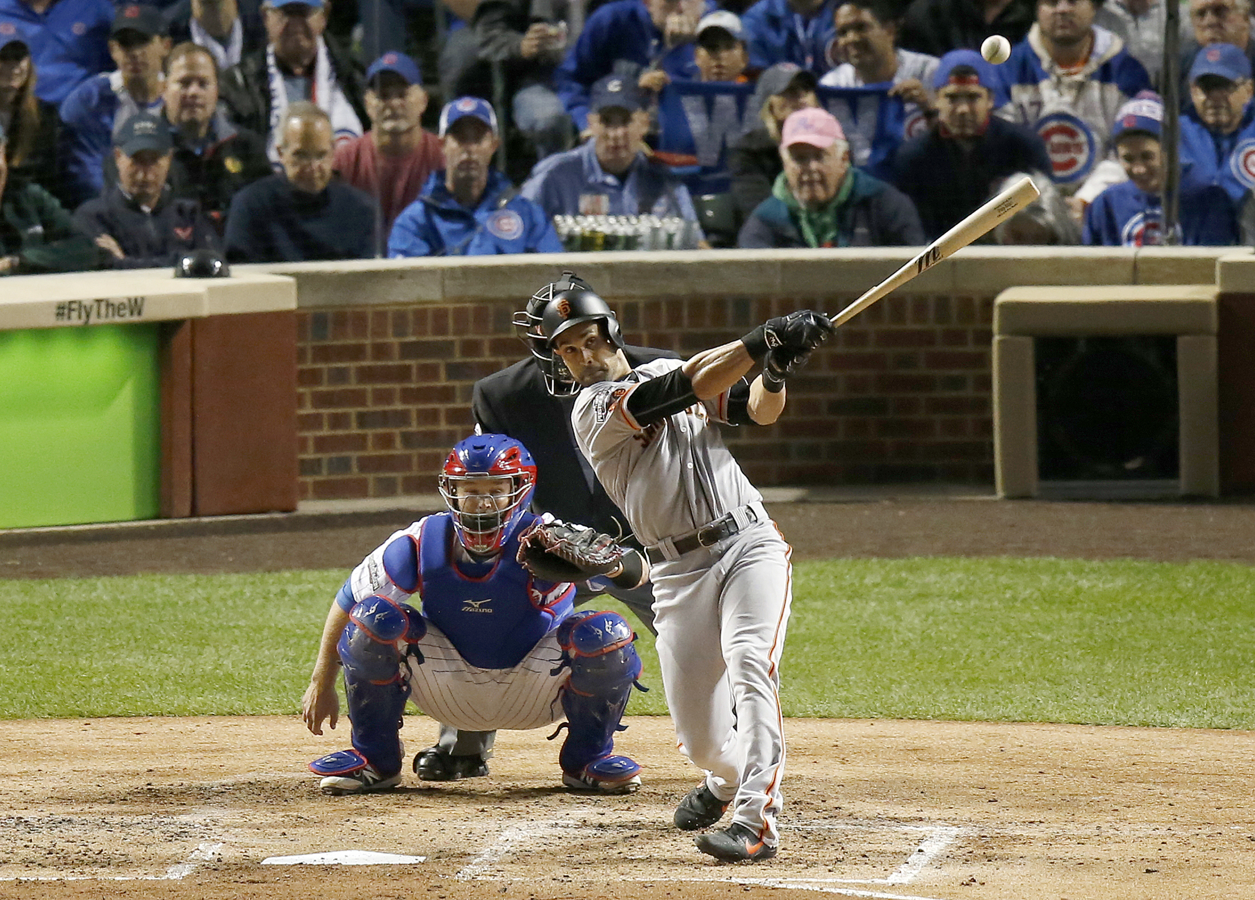 San Francisco Giants' Angel Pagan hits a double in the fourth inning of Game 1 of baseball's National League Division Series against the Chicago Cubs, Friday, Oct. 7, 2016, in Chicago. (AP Photo/Charles Rex Arbogast)