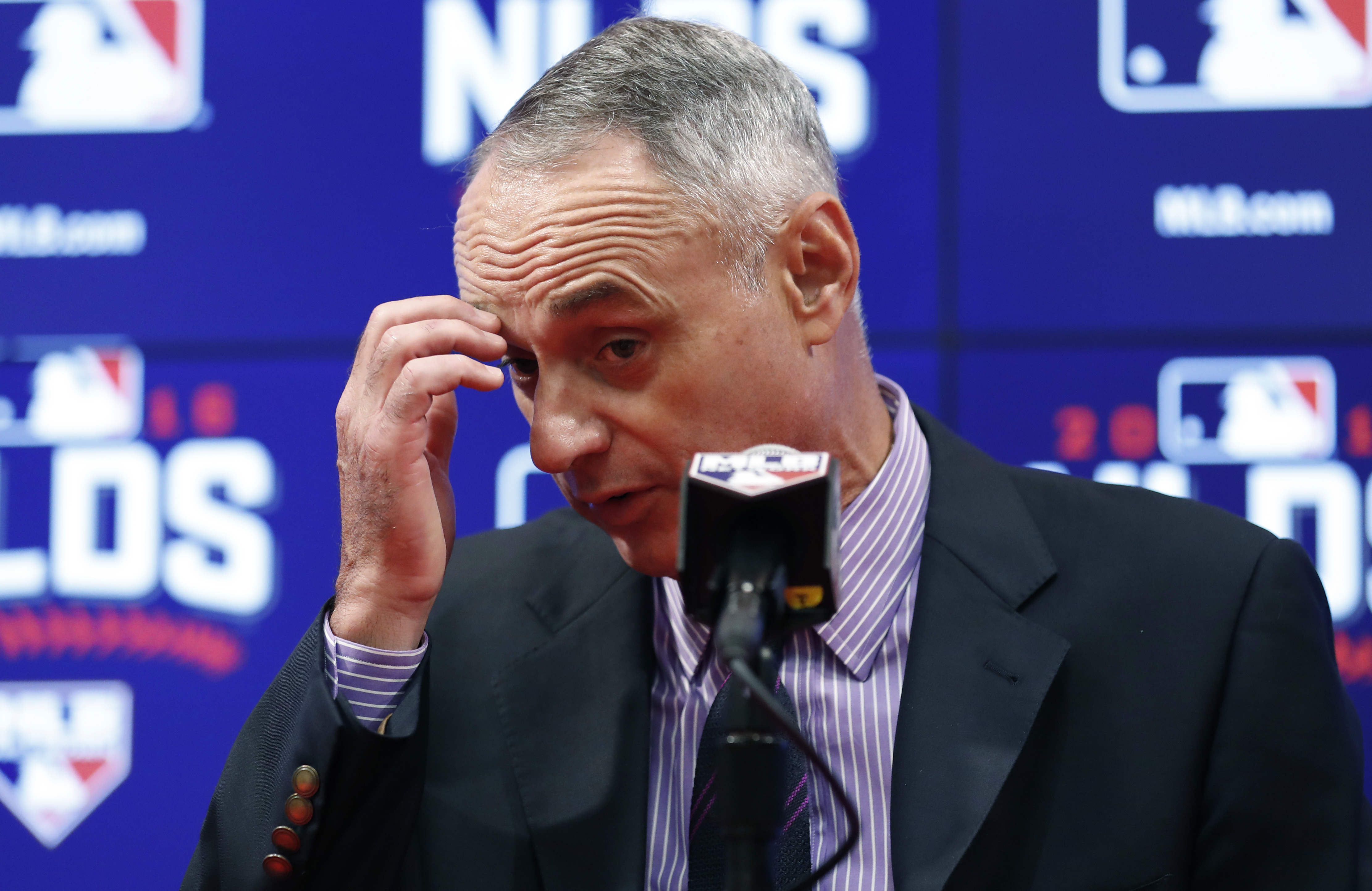 Baseball commissioner Rob Manfred pauses during a media availability before Game 2 of baseball's National League Division Series between the Washington Nationals and the Los Angeles Dodgers, at Nationals Park, Saturday, Oct. 8, 2016, in Washington. Manfre