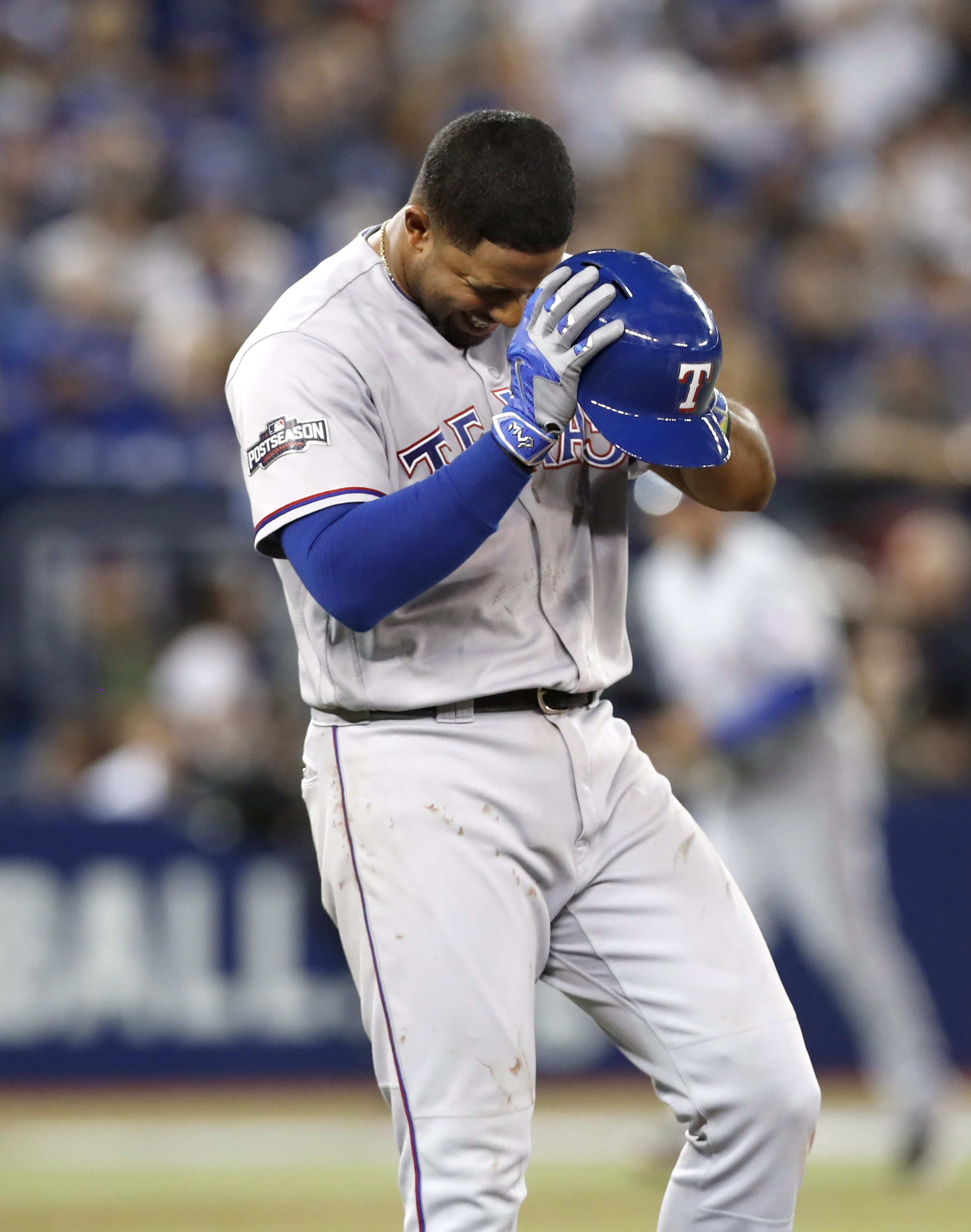 Texas Rangers' Elvis Andrus reacts after flying out during sixth inning game three American League Division Series baseball action in Toronto on Sunday, Oct. 9, 2016. (Mark Blinch/The Canadian Press via AP)