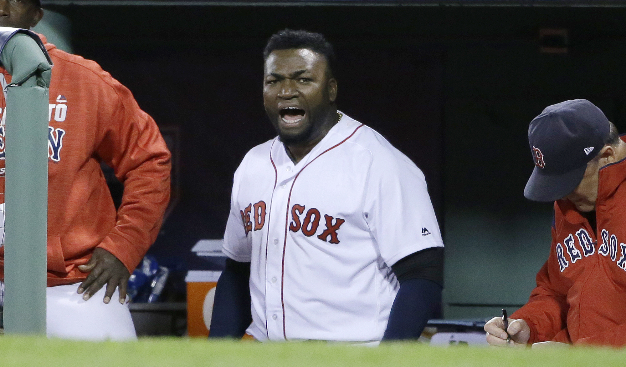 Boston Red Sox designated hitter David Ortiz encourages the crowd from the dugout during the eighth inning in Game 3 of baseball's American League Division Series against the Cleveland Indians, Monday, Oct. 10, 2016, in Boston. (AP Photo/Elise Amendola)