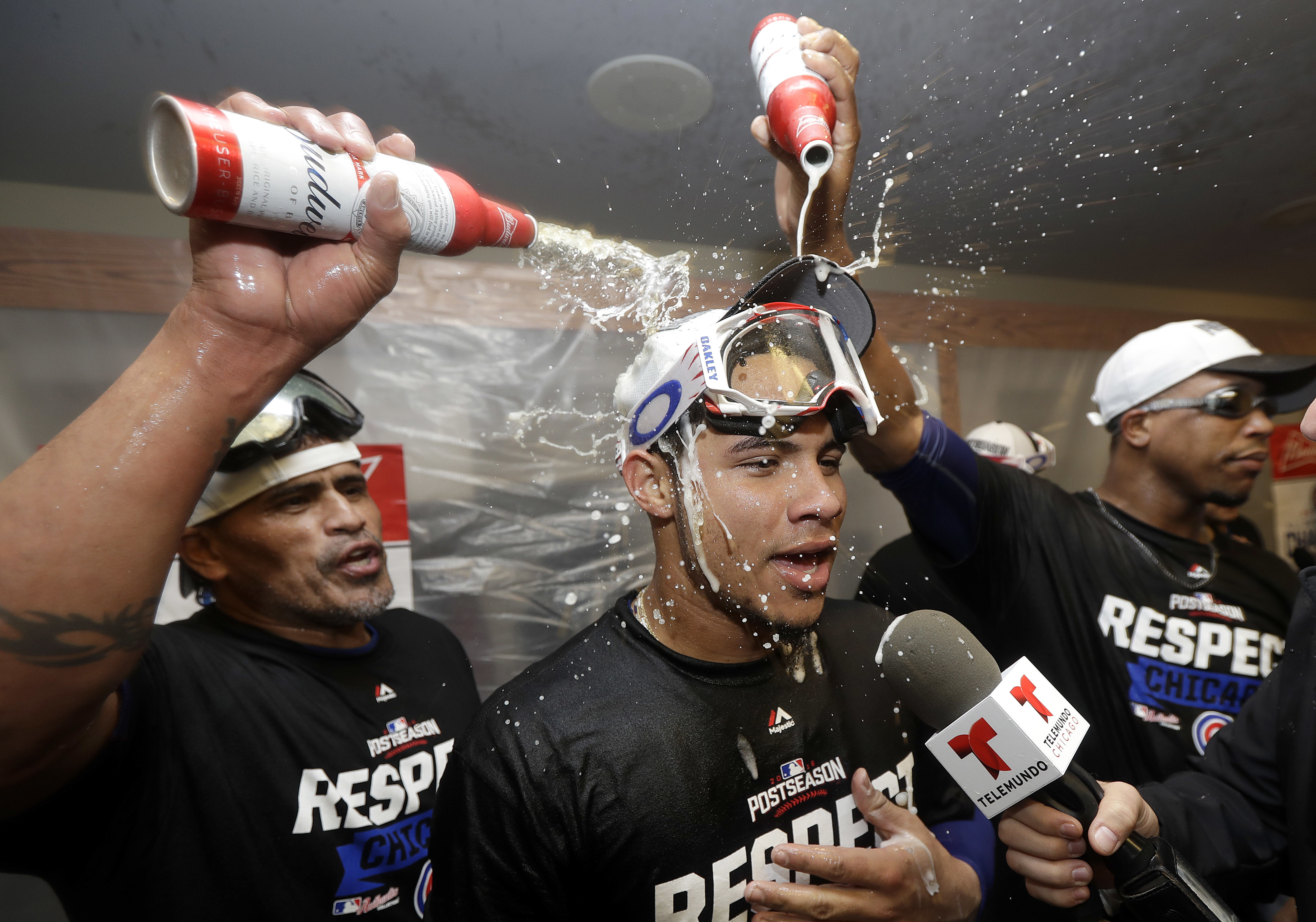 Chicago Cubs catcher Willson Contreras, center, has beer poured on him in the locker room after Game 4 of baseball's National League Division Series against the San Francisco Giants in San Francisco, Tuesday, Oct. 11, 2016. The Cubs won 6-5. (AP Photo/Mar