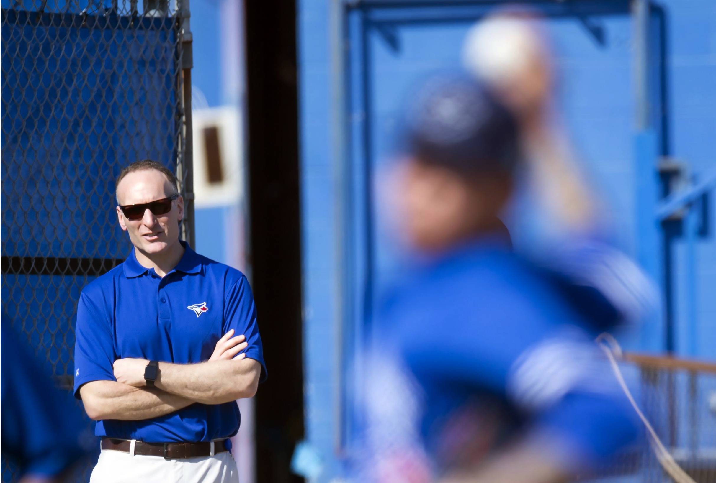 FILE - In this Feb. 22, 2016, file photo, Toronto Blue Jays President and CEO Mark Shapiro watches the first official spring training baseball workout in Dunedin, Fla. Shapiro is the man in the middle of the ALCS. Torontos president and CEO spent half of