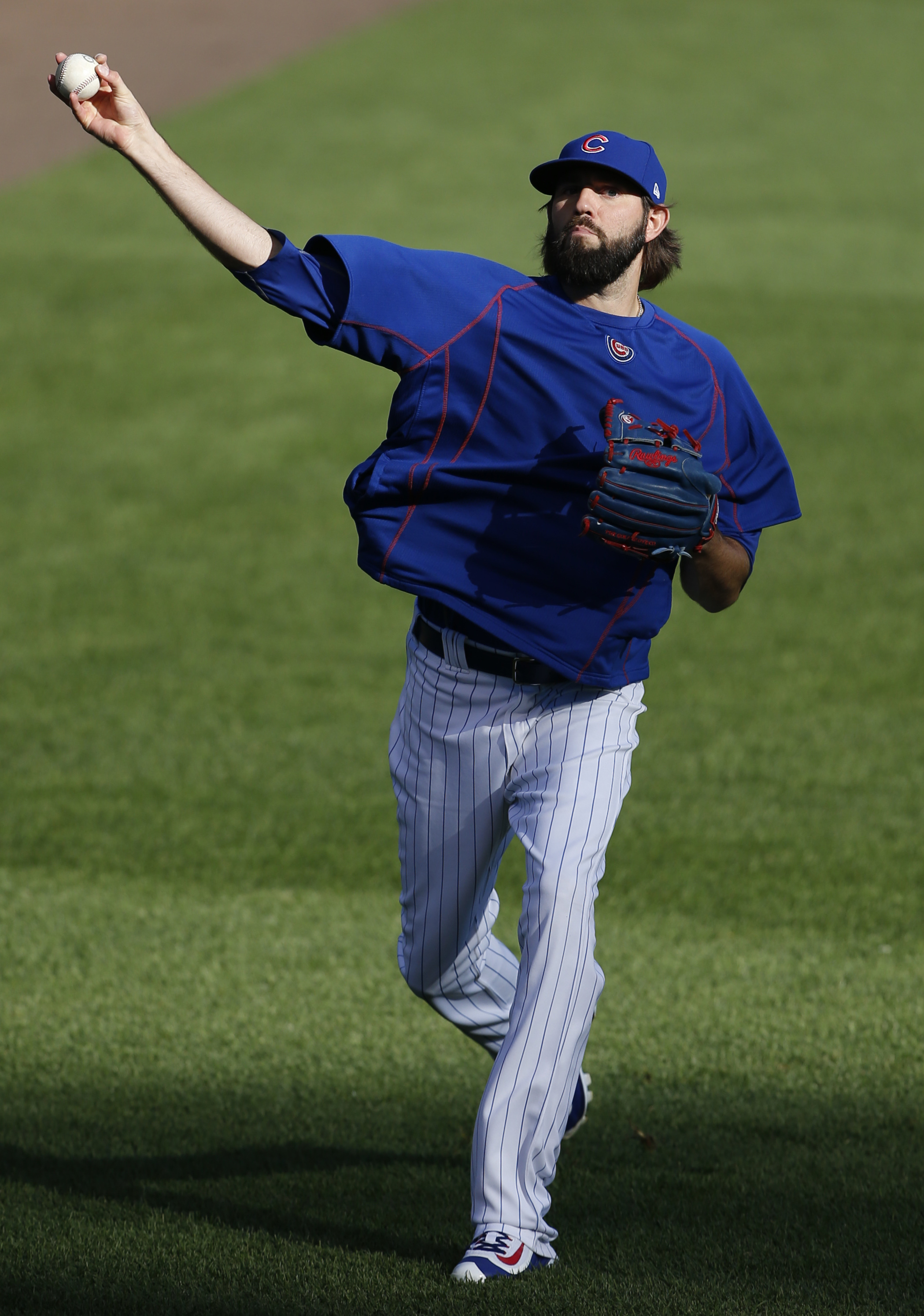 Chicago Cubs pitcher Jason Hammel throws a ball during a team workout in preparation for Saturday's Game 1 in baseball's National League Championship Series in Chicago, Thursday, Oct. 13, 2016. (AP Photo/Nam Y. Huh)