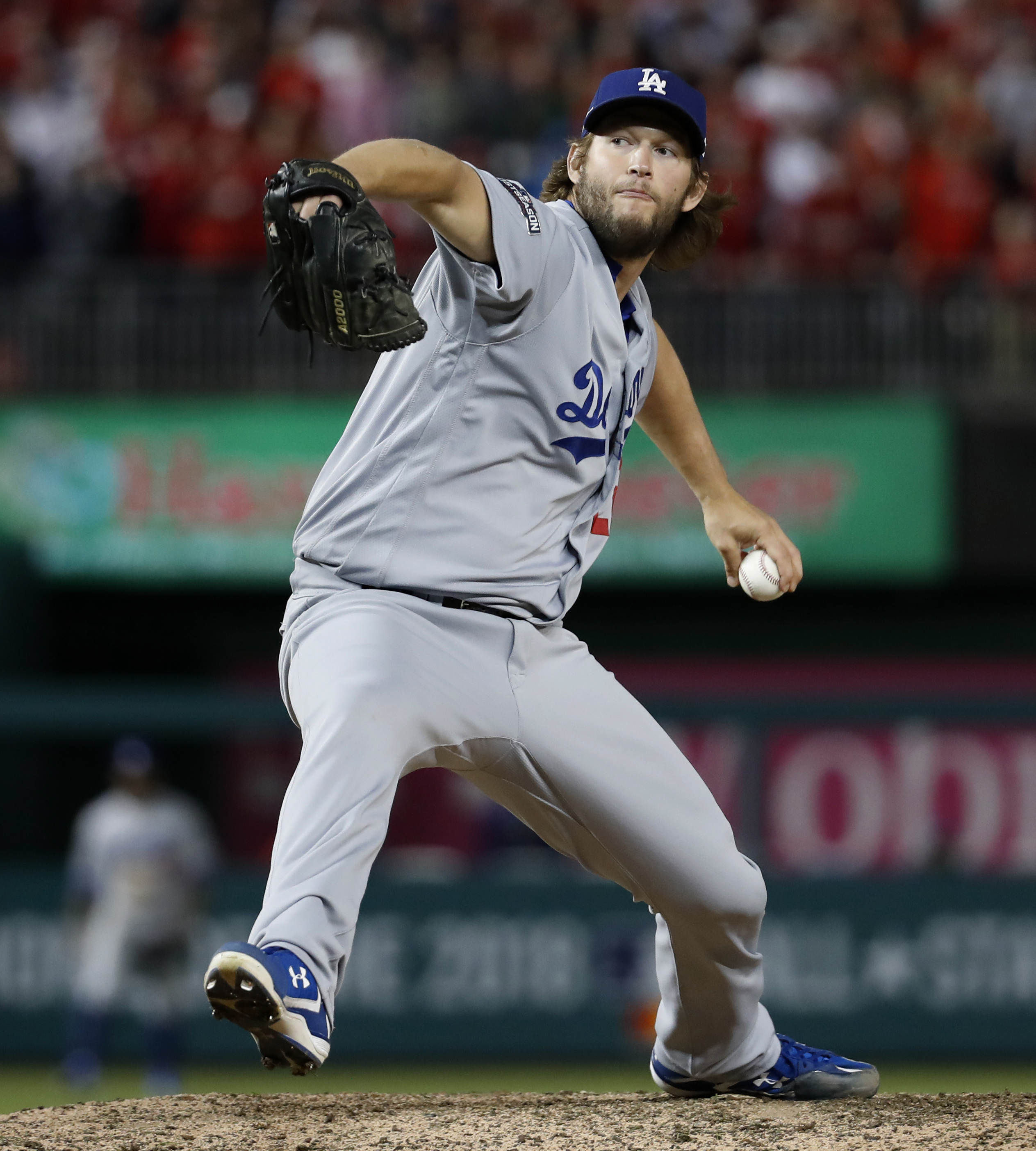 Los Angeles Dodgers pitcher Clayton Kershaw winds up during the ninth inning of Game 5 of a baseball National League Division Series, against the Washington Nationals at Nationals Park early Friday, Oct. 14, 2016, in Washington. The Dodgers won 4-3. (AP P