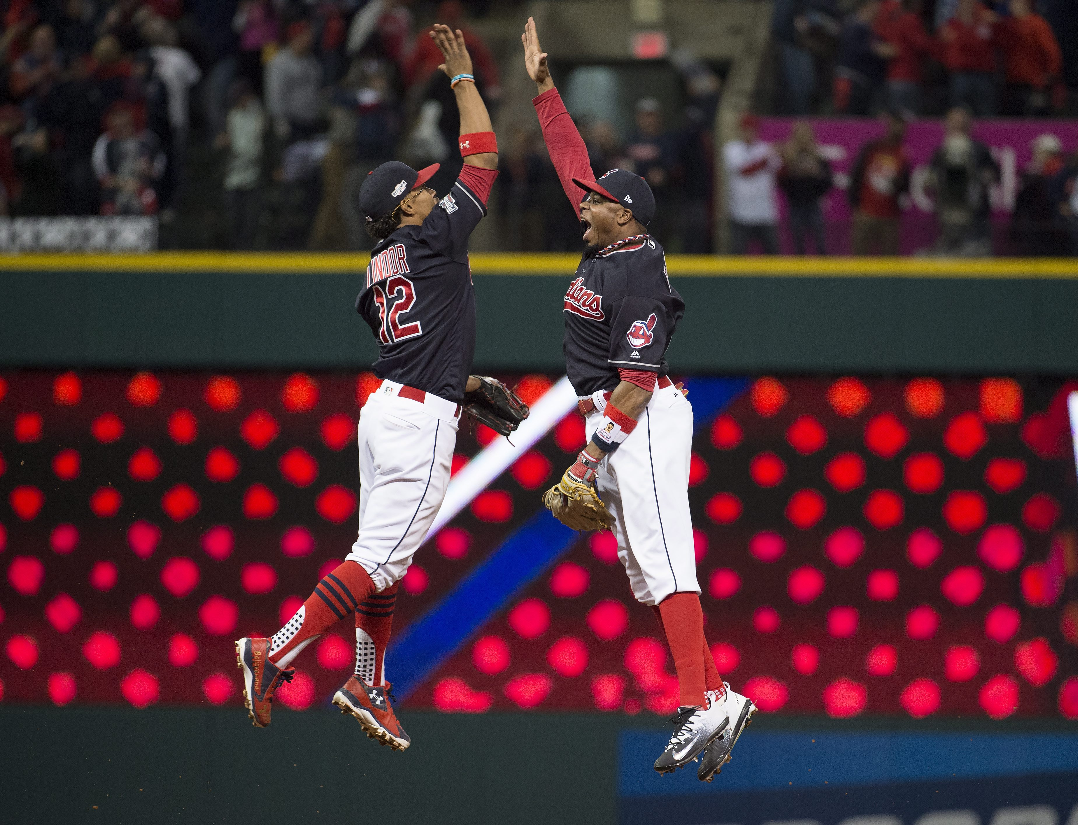 Cleveland Indians' Francisco Lindor, left, and Rajai Davis celebrate the Indians' 2-0 victory over the Toronto Blue Jays in Game 1 of the baseball American League Championship Series, Friday, Oct. 14, 2016, in Cleveland. (Nathan Denette/The Canadian Press
