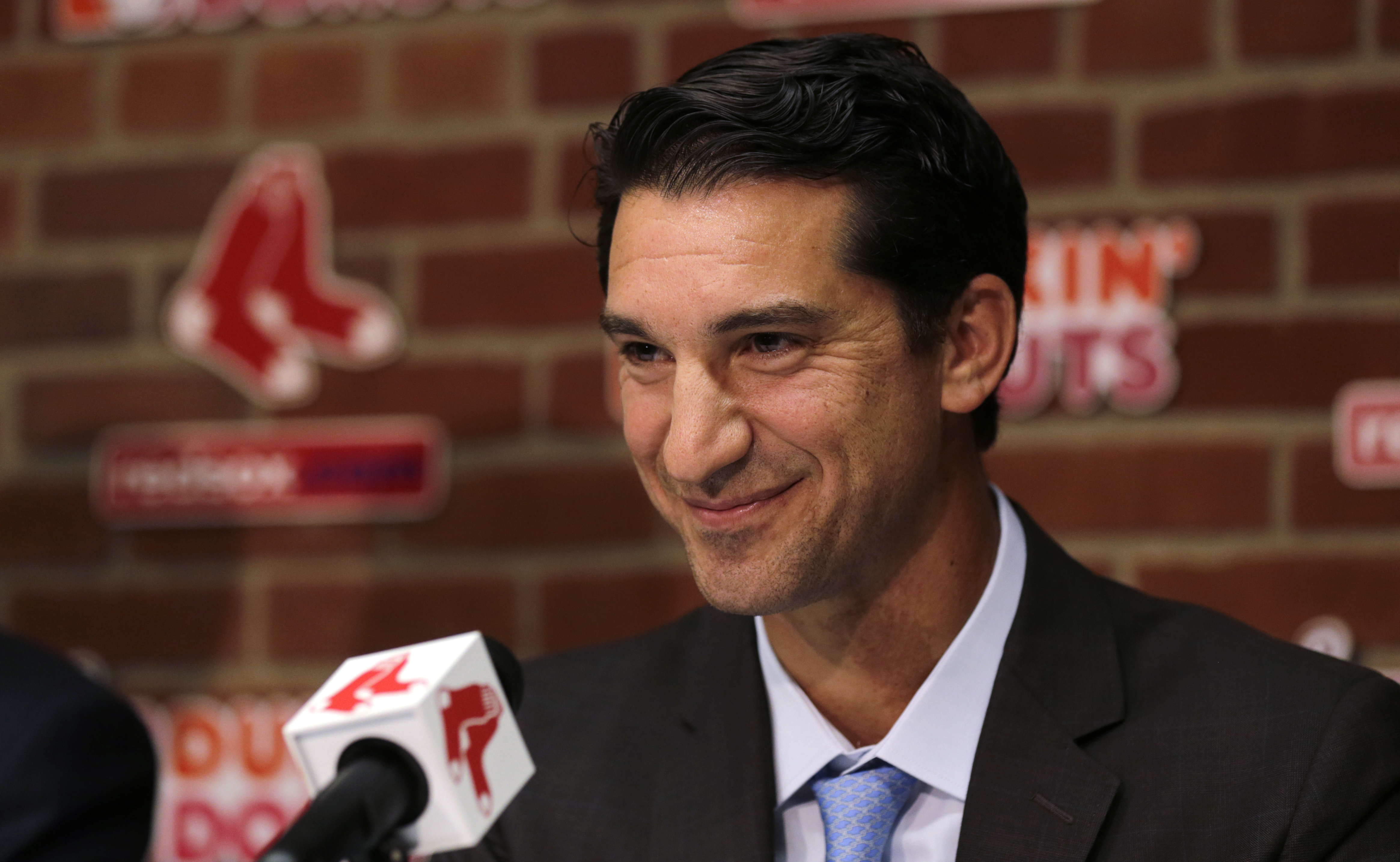 FILE - In this Sept. 24, 2015, file photo, Boston Red Sox newly appointed general manager Mike Hazen smiles at Fenway Park in Boston. The Arizona Diamondbacks have named Hazen as executive vice president and general manager. The team announced the hiring