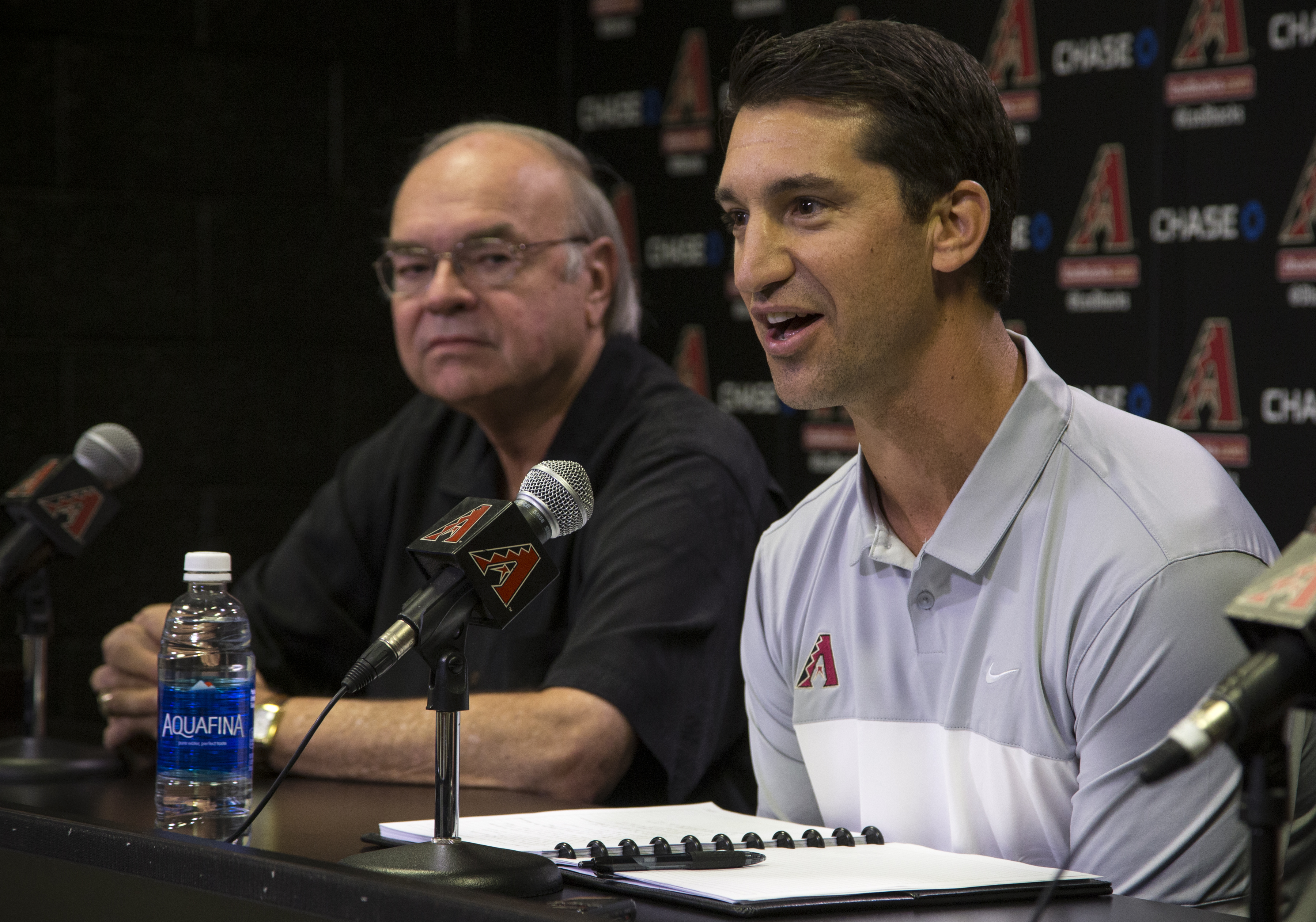 Mike Hazen, right, answers questions, Monday, Oct. 17, 2016, during a news conference in Phoenix. Looking on is Managing General Partner Ken Kendrick. The Arizona Diamondbacks have hired Boston Red Sox general manager Mike Hazen as their general manager.