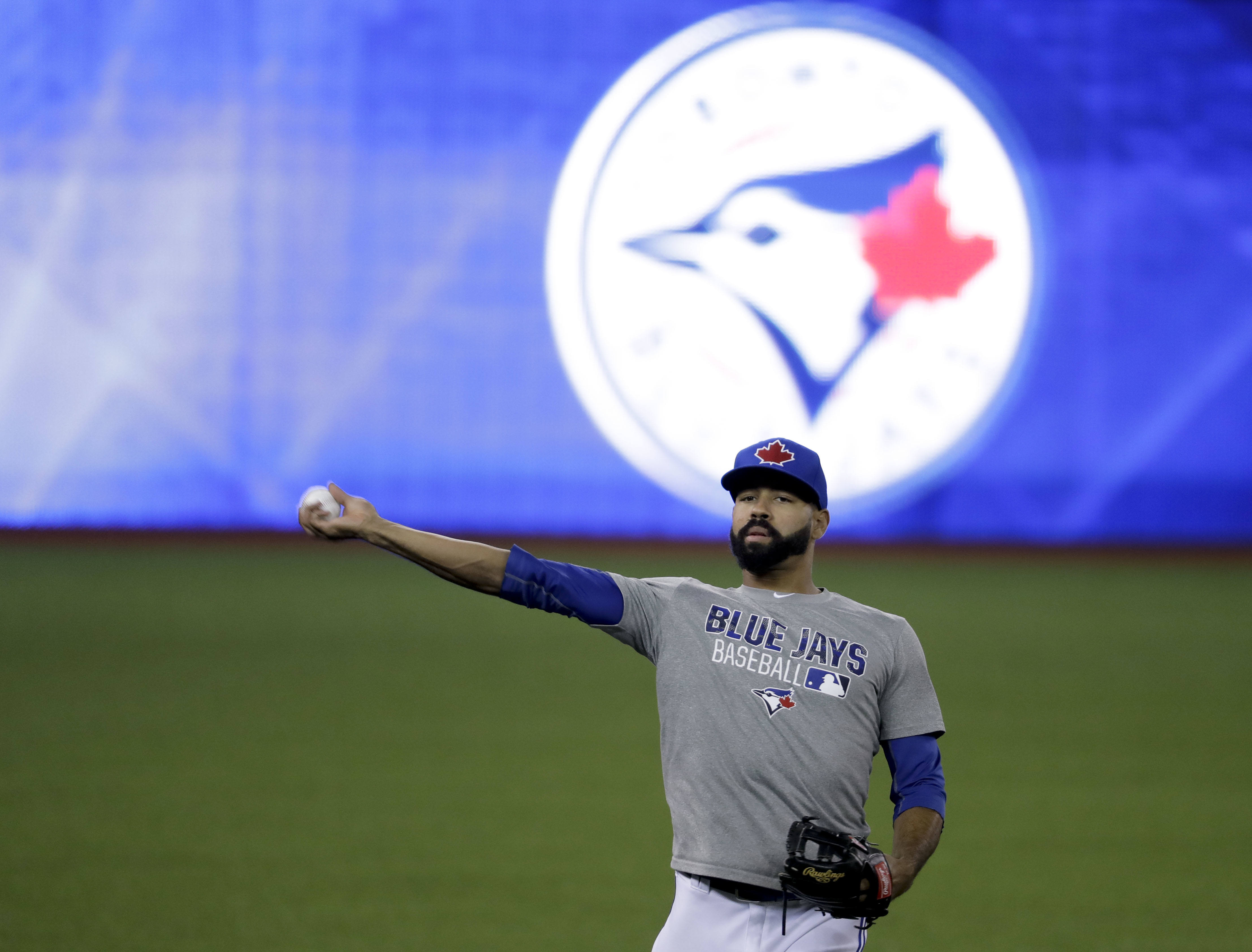 Toronto Blue Jays right fielder Jose Bautista warms up before Game 3 of baseball's American League Championship Series against the Cleveland Indians in Toronto, Monday, Oct. 17, 2016. (AP Photo/Charlie Riedel)