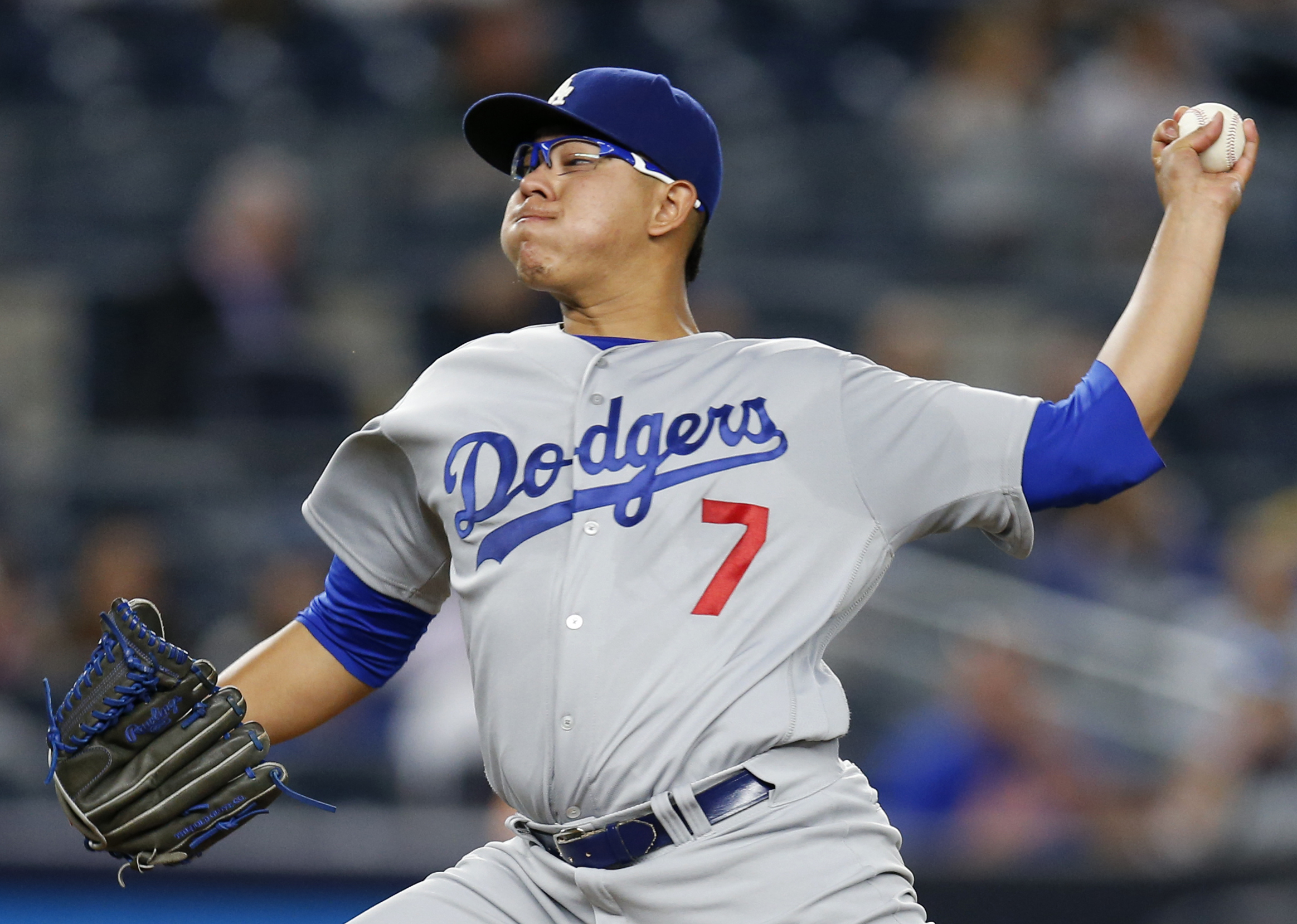 CORRECTS TO NEW YORK YANKEES INSTEAD OF NEW YORK METS IN FIRST SENTENCE FILE - This Sept. 13, 2016 file photo shows Los Angeles Dodgers' starting pitcher Julio Urias delivering during the first inning of a baseball game against the New York Yankees in New