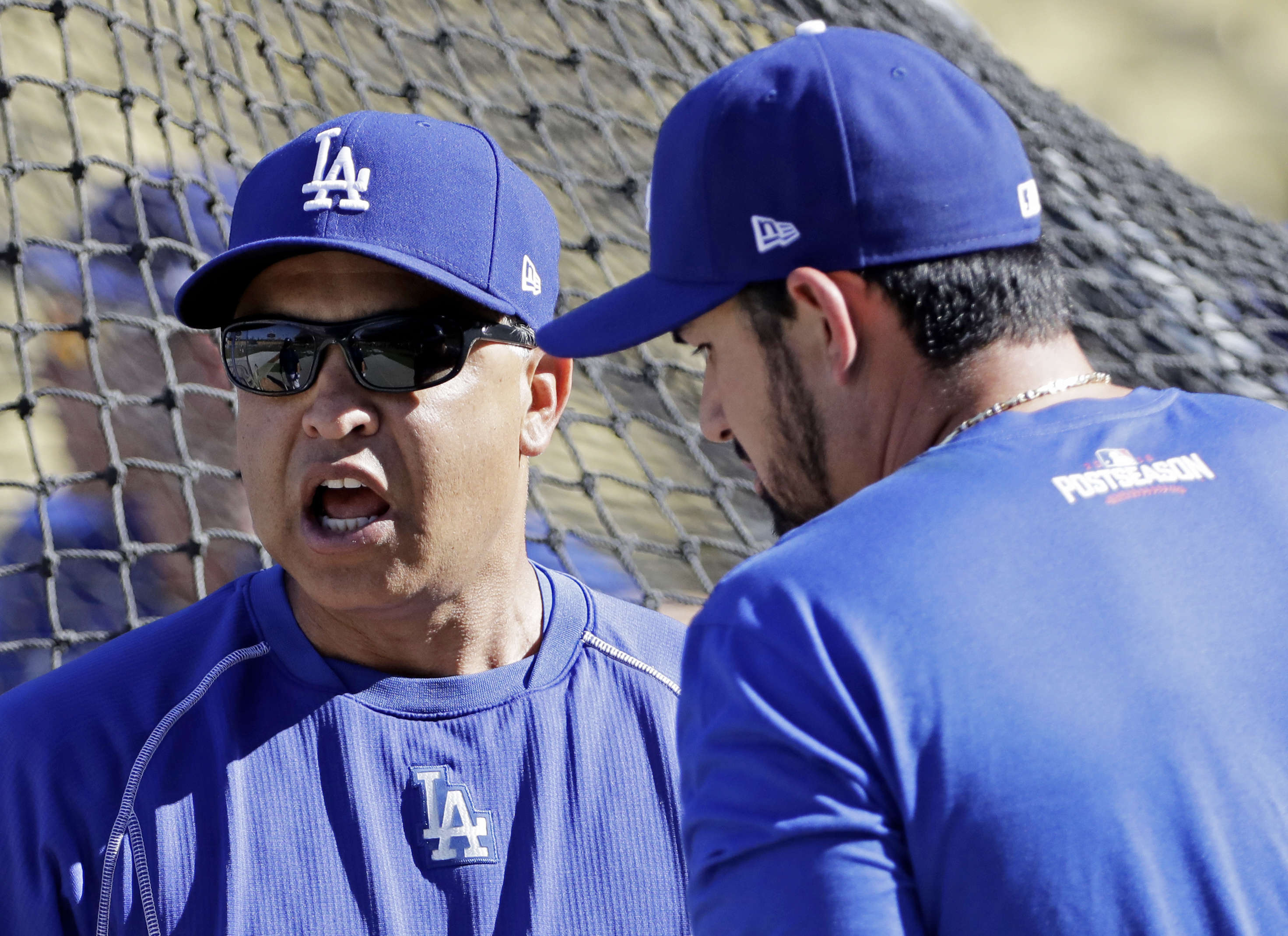 Los Angeles Dodgers manager Dave Roberts talks to Adrian Gonzalez before Game 4 of the National League baseball championship series against the Chicago Cubs Wednesday, Oct. 19, 2016, in Los Angeles. (AP Photo/David J. Phillip)