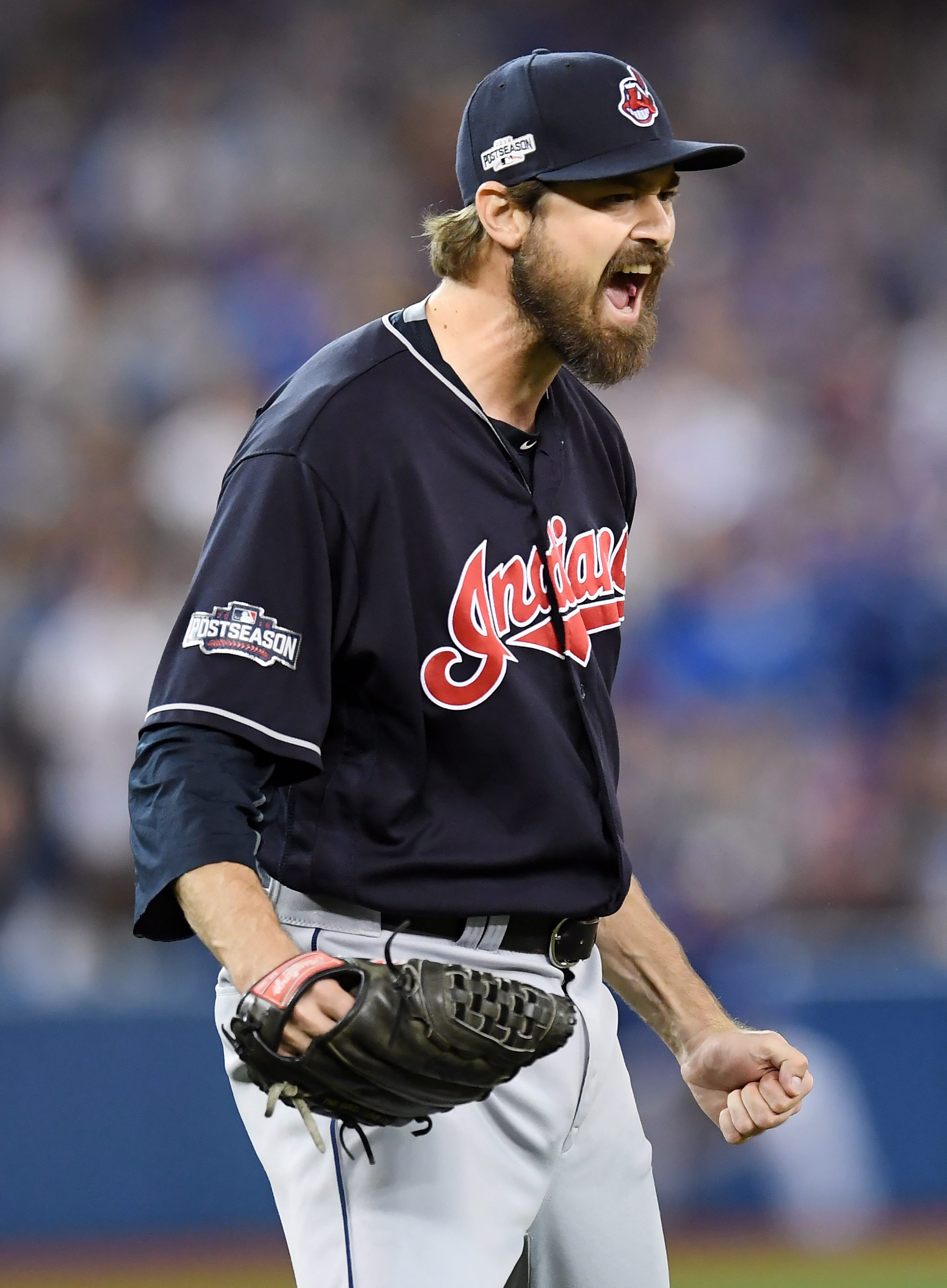 Cleveland Indians relief pitcher Andrew Miller celebrates after Toronto Blue Jays' Josh Donaldson hit into an inning-ending double play during sixth inning during Game 5 of baseball's American League Championship Series in Toronto, Wednesday, Oct. 19, 201