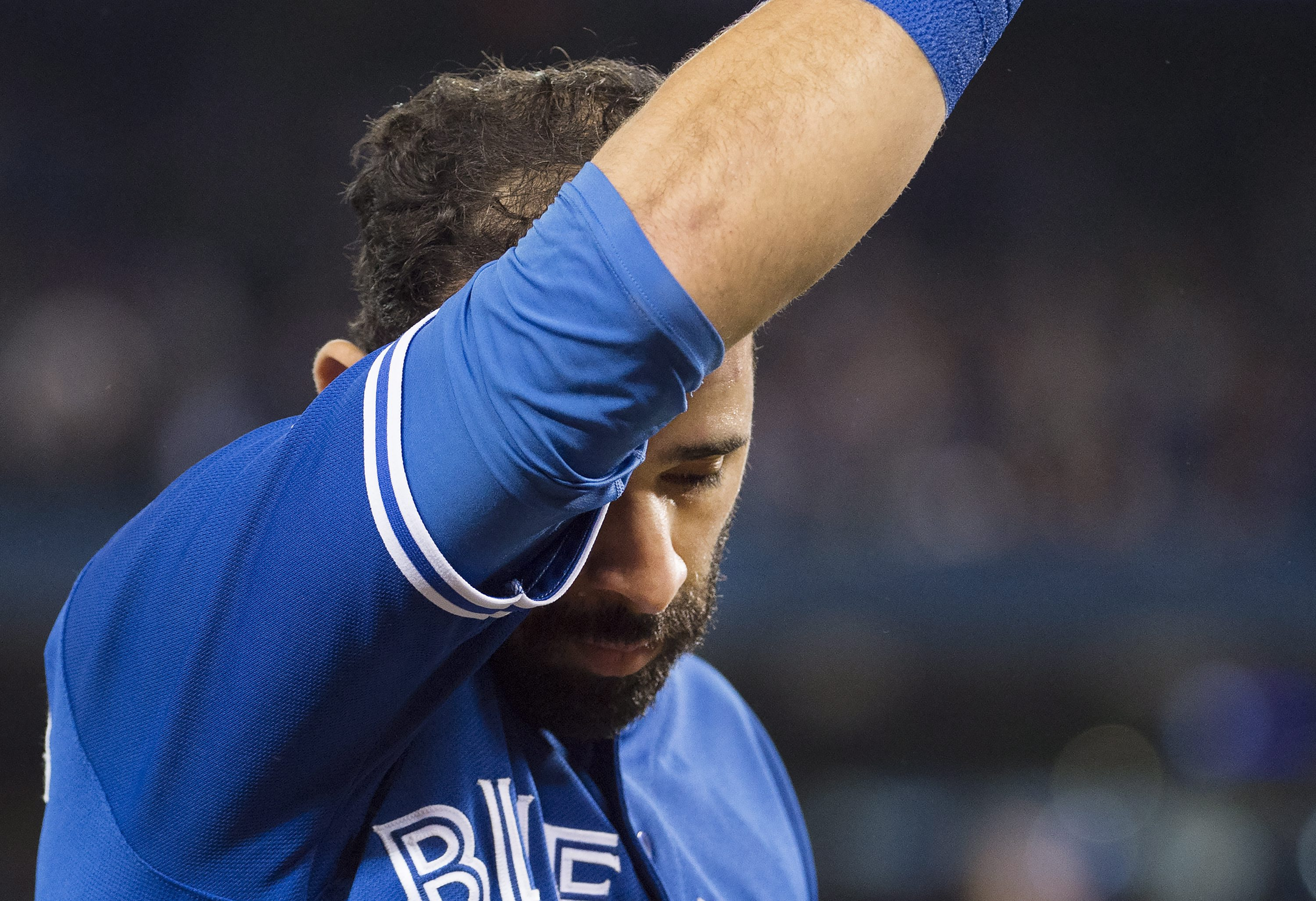 Toronto Blue Jays right fielder Jose Bautista reacts after the Cleveland Indians defeated the Blue Jays 3-0 in Game 5 of the baseball American League Championship Series in Toronto on Wednesday, Oct. 19, 2016. (Nathan Denette/The Canadian Press via AP)