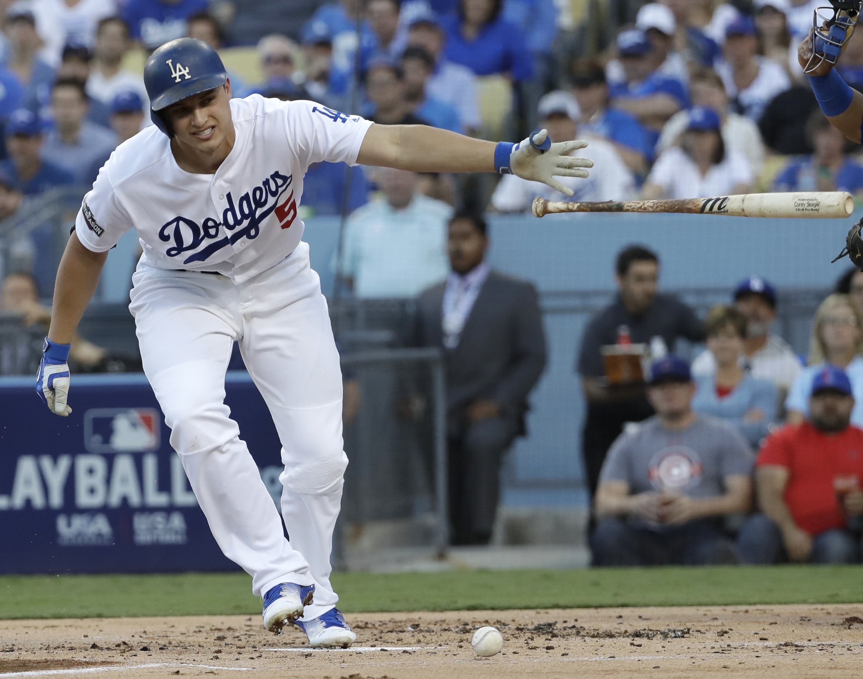 Los Angeles Dodgers' Corey Seager is hit by a pitcher during the first inning of Game 4 of the National League baseball championship series against the Chicago Cubs Wednesday, Oct. 19, 2016, in Los Angeles. (AP Photo/David J. Phillip)