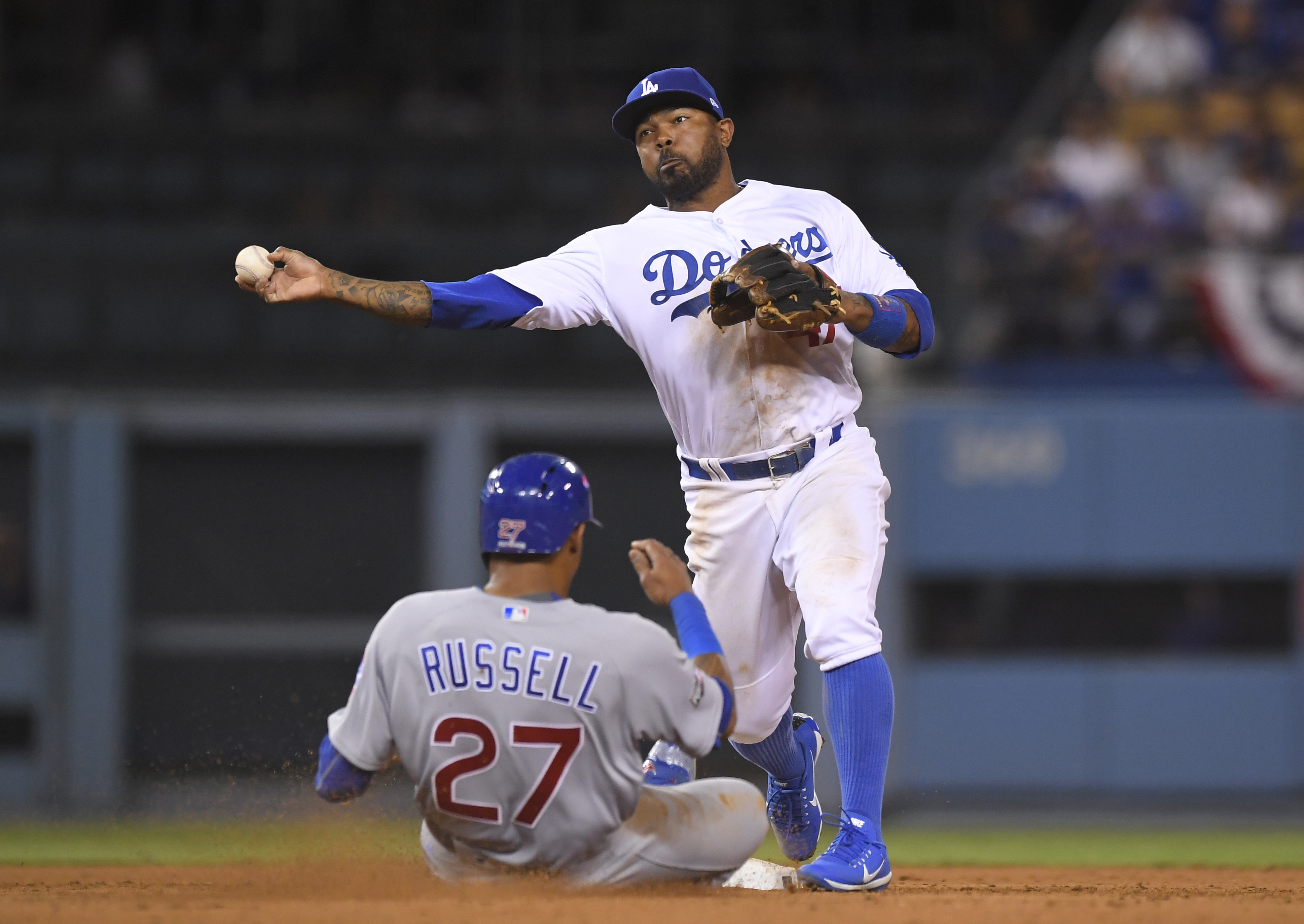 Chicago Cubs' Addison Russell is out at second as Los Angeles Dodgers' Howie Kendrick turns a double play on a ball hit by Albert Almora Jr. during the ninth inning of Game 5 of the National League baseball championship series Thursday, Oct. 20, 2016, in