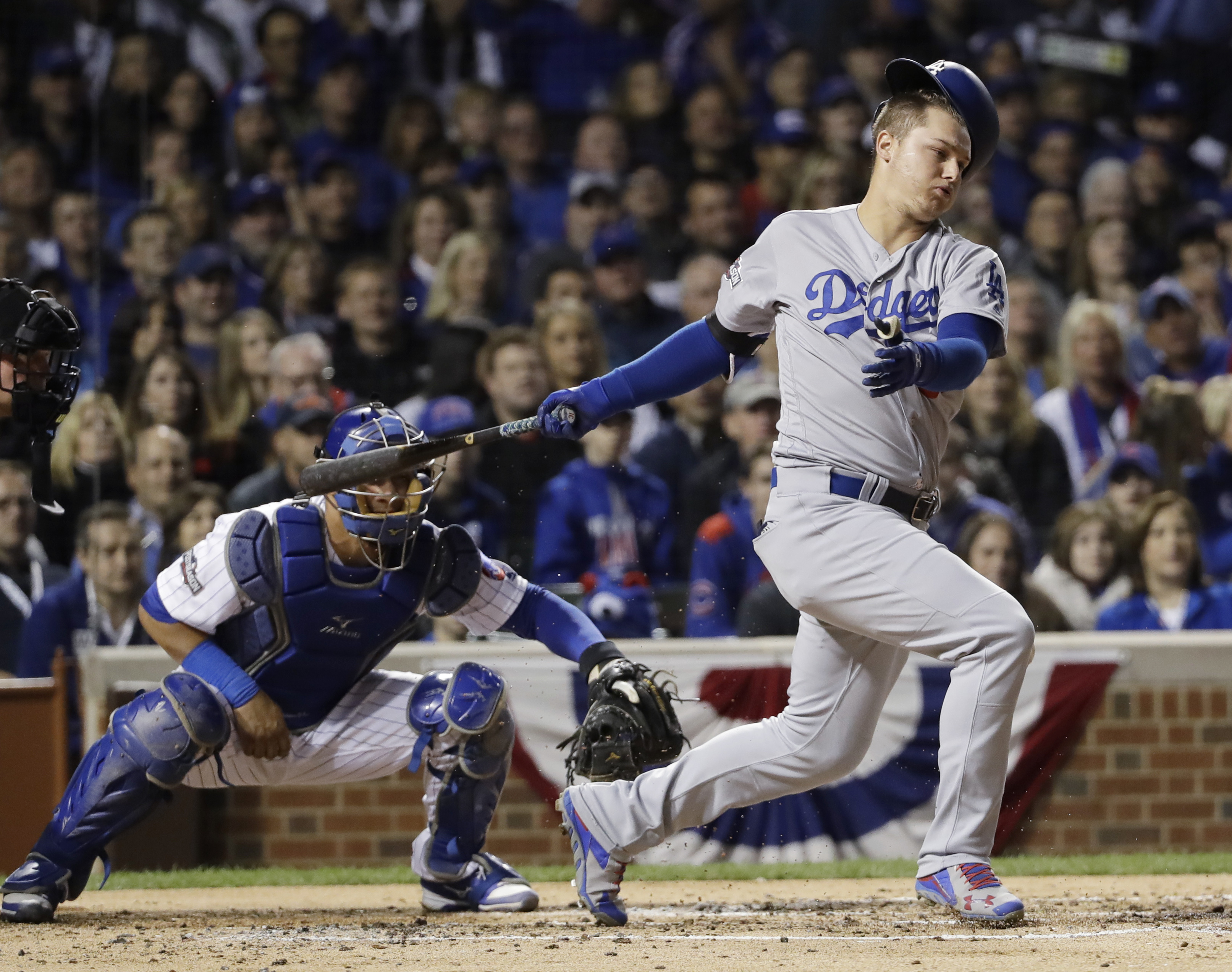 Los Angeles Dodgers center fielder Joc Pederson (31) loses his helmet as he swings strike during the second inning of Game 6 of the National League baseball championship series against the Chicago Cubs, Saturday, Oct. 22, 2016, in Chicago. (AP Photo/David