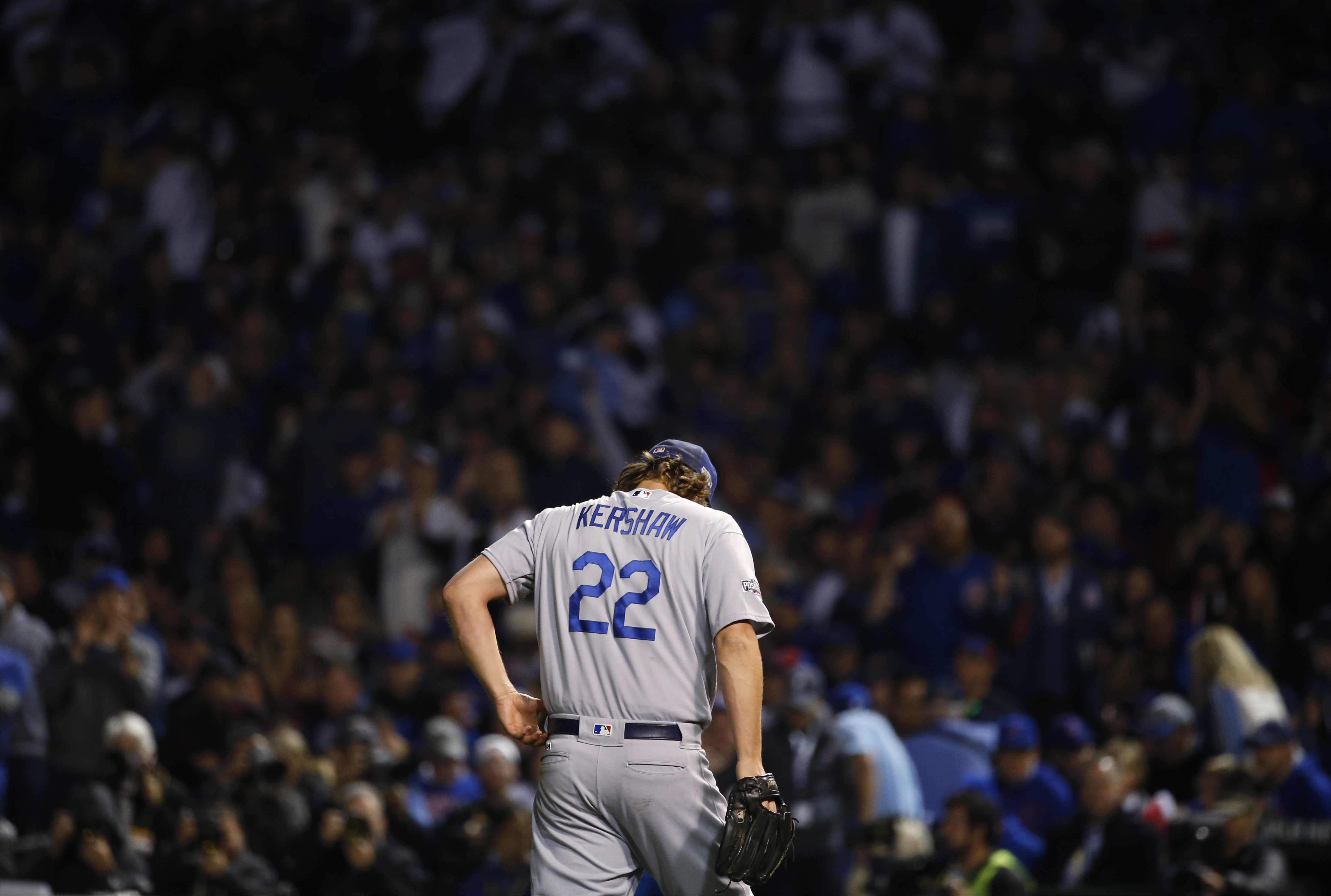 Los Angeles Dodgers starting pitcher Clayton Kershaw (22) walks back to the dugout after the fifth inning of Game 6 of the National League baseball championship series against the Chicago Cubs, Saturday, Oct. 22, 2016, in Chicago. (AP Photo/Nam Y. Huh)