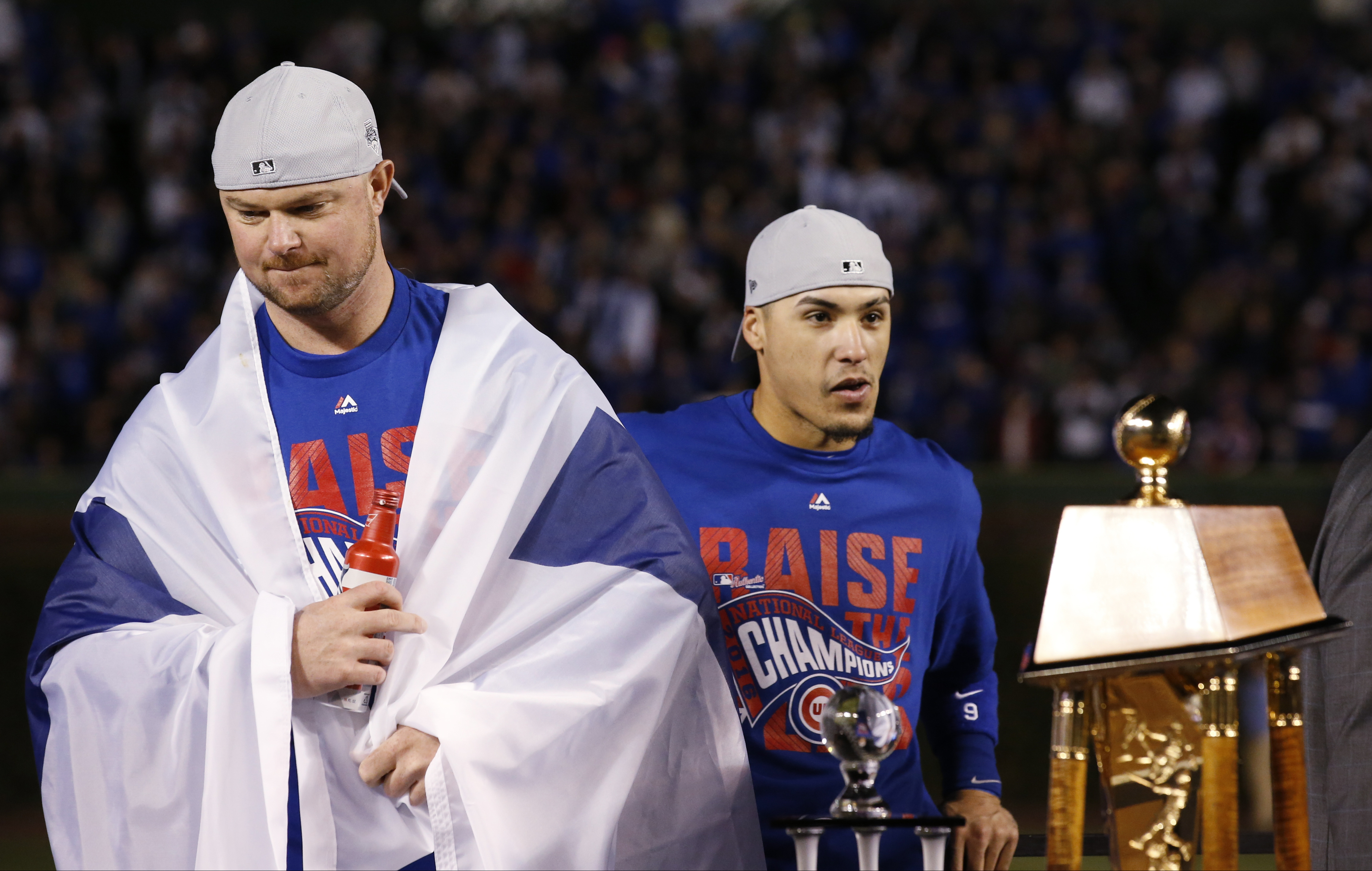 Chicago Cubs' Jon Lester, left, and Javier Baez celebrate after Game 6 of the National League baseball championship series against the Los Angeles Dodgers, Saturday, Oct. 22, 2016, in Chicago. The Cubs won 5-0 to win the series and advance to the World Se