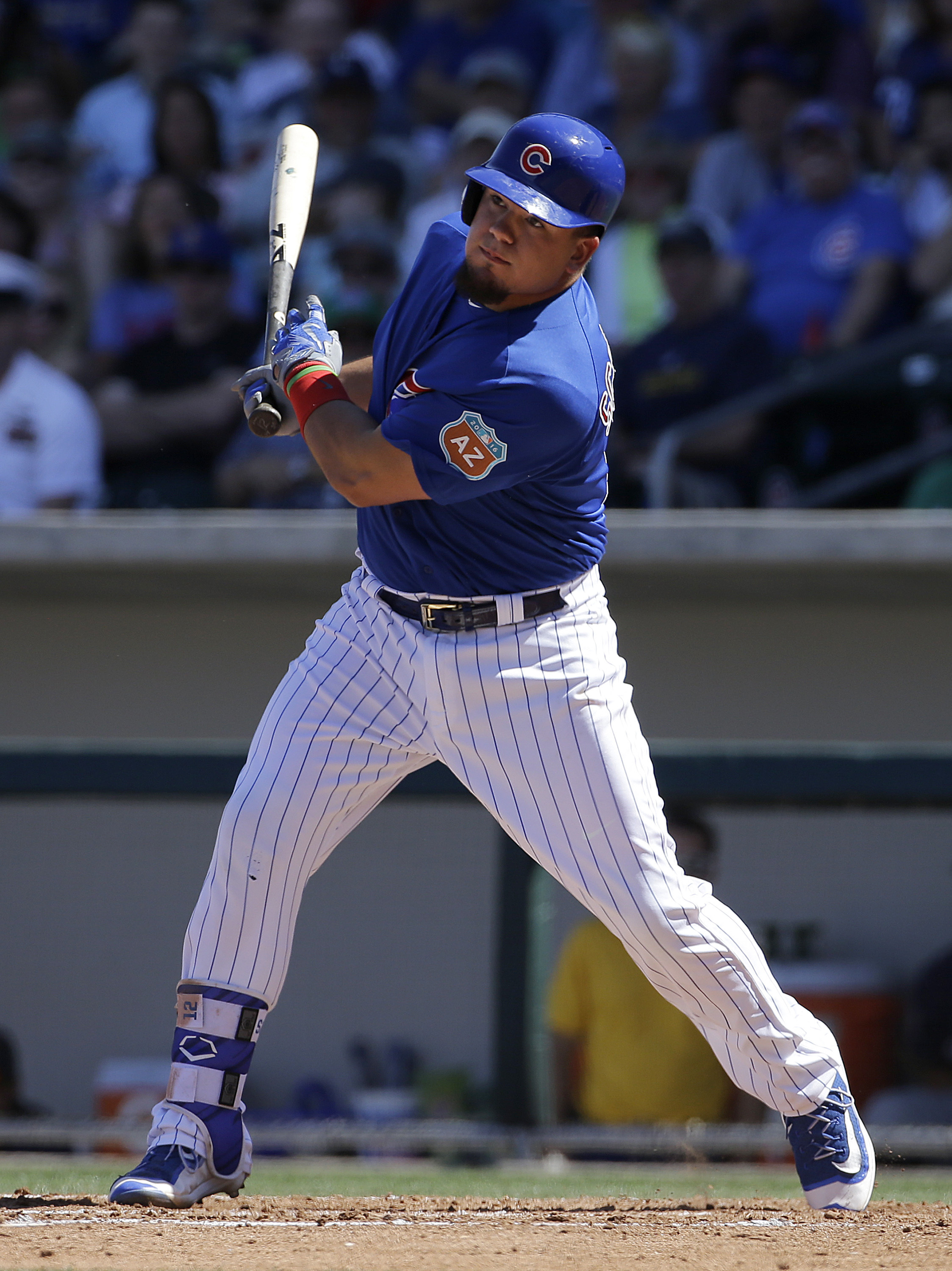 FILE - In this March 25, 2016, file photo, Chicago Cubs' Kyle Schwarber swings against the Milwaukee Brewers during a spring training baseball game in Mesa, Ariz. Right after the Cubs reached the World Series for the first time since 1945, the focus shift