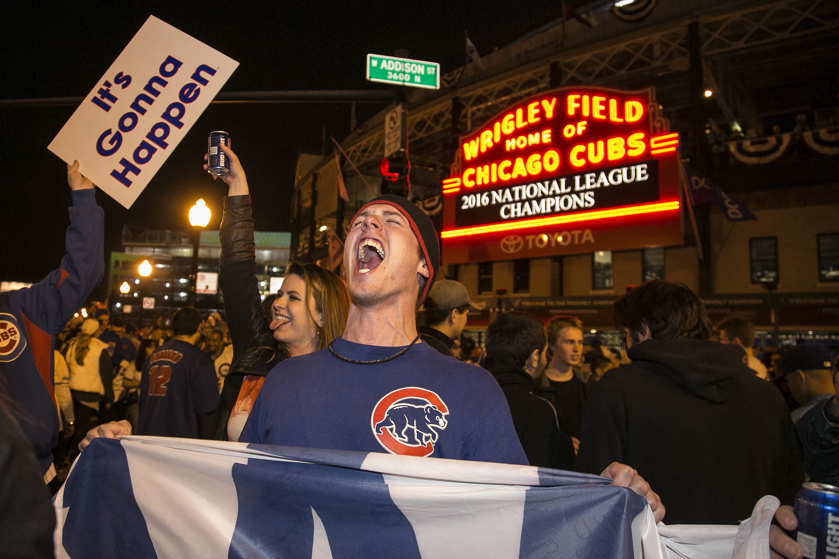 FILE - In this Oct. 22, 2016, file photo, Chicago Cubs fans celebrate outside Wrigley Field after the Cubs defeated the Los Angeles Dodgers 5-0 in Game 6 of baseball's National League Championship Series in Chicago. Fans who are hoping to see the Cubs pla