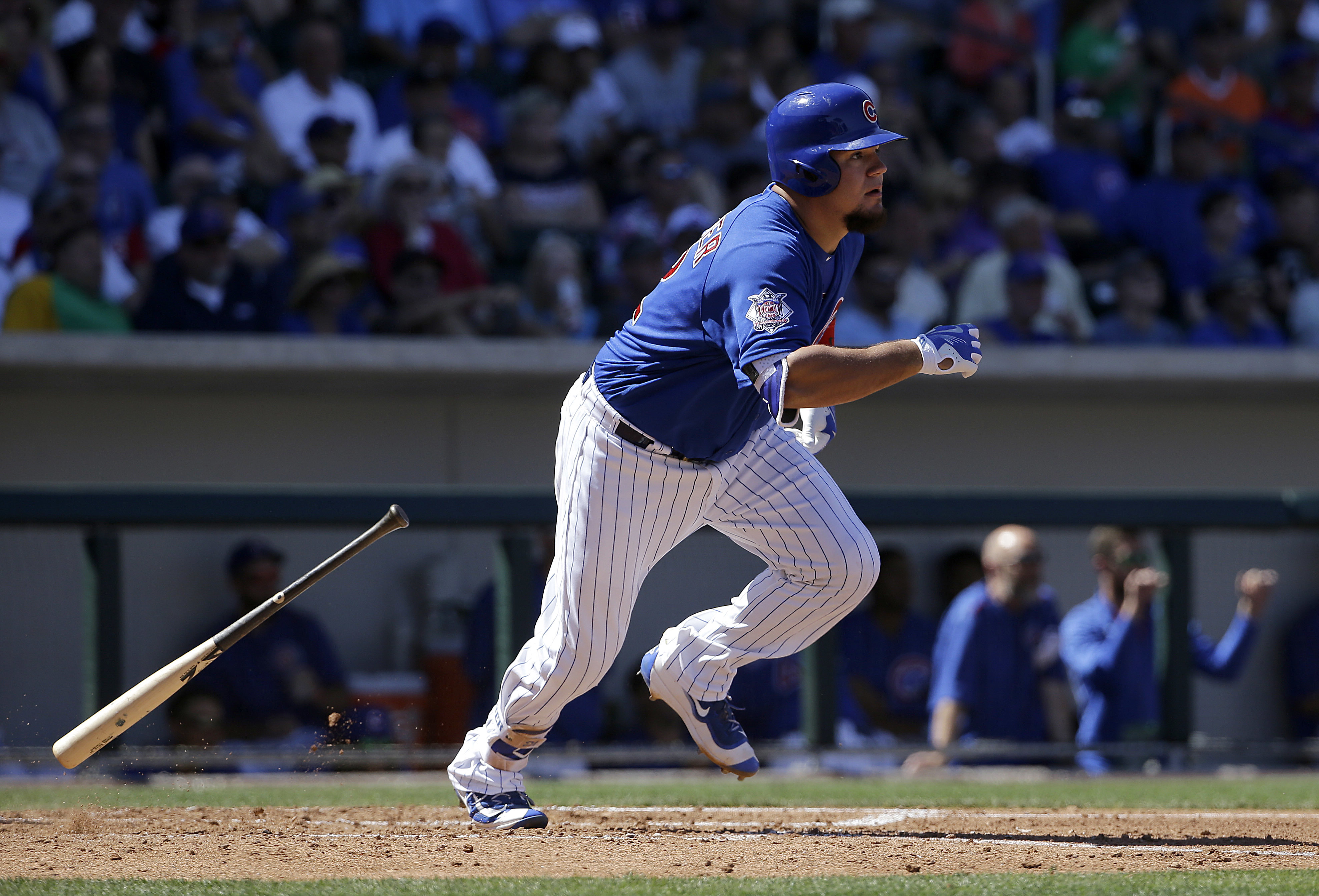 FILE - In this March 26, 2016, file photo, Chicago Cubs' Kyle Schwarber bats against the San Francisco Giants during a spring training baseball game in Mesa, Ariz. Schwarber has been added to the Chicago Cubs' World Series roster and could start Tuesday n