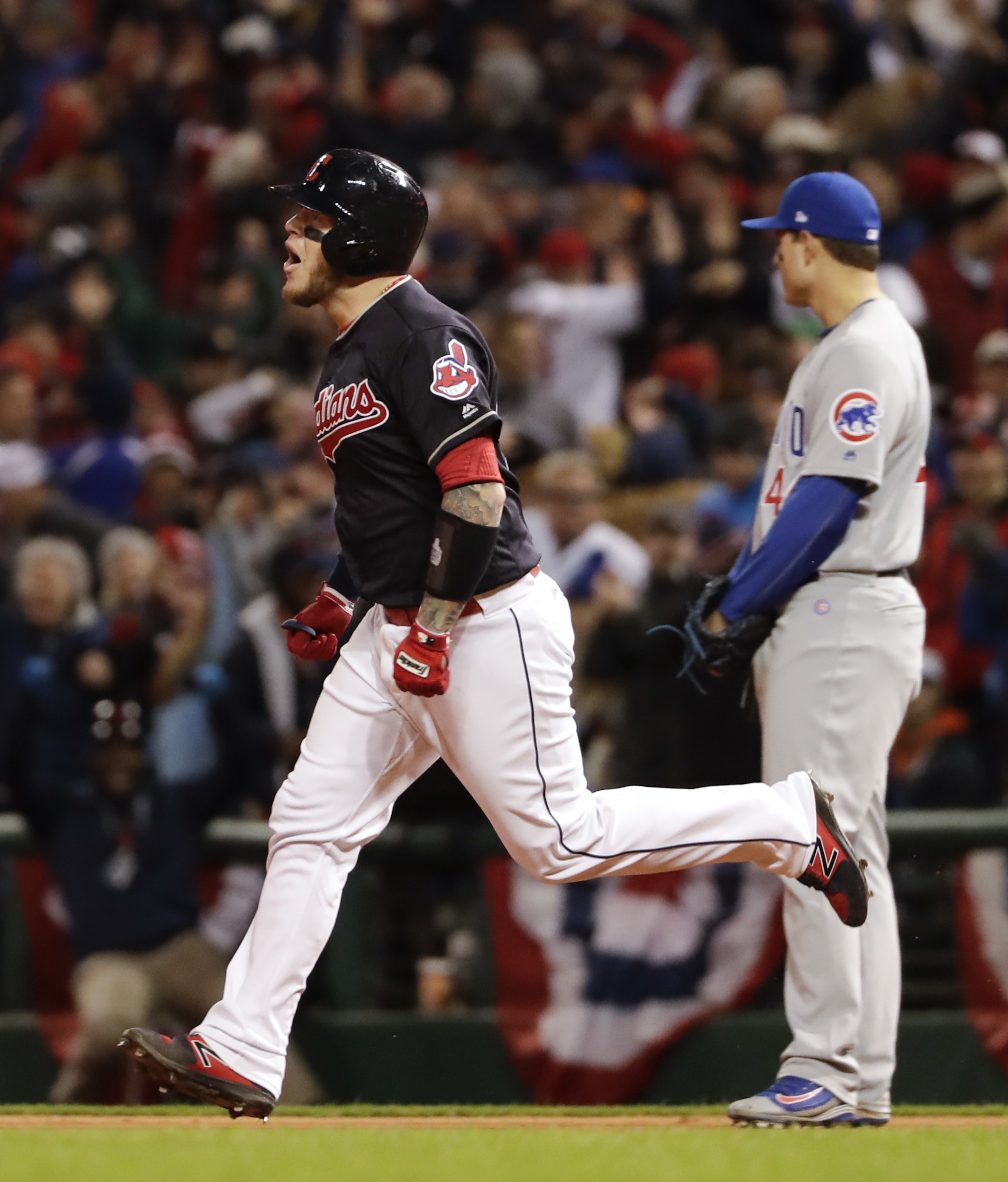 Cleveland Indians' Roberto Perez celebrates after his home run against the Chicago Cubs during the eighth inning of Game 1 of the Major League Baseball World Series Tuesday, Oct. 25, 2016, in Cleveland. (AP Photo/Matt Slocum)