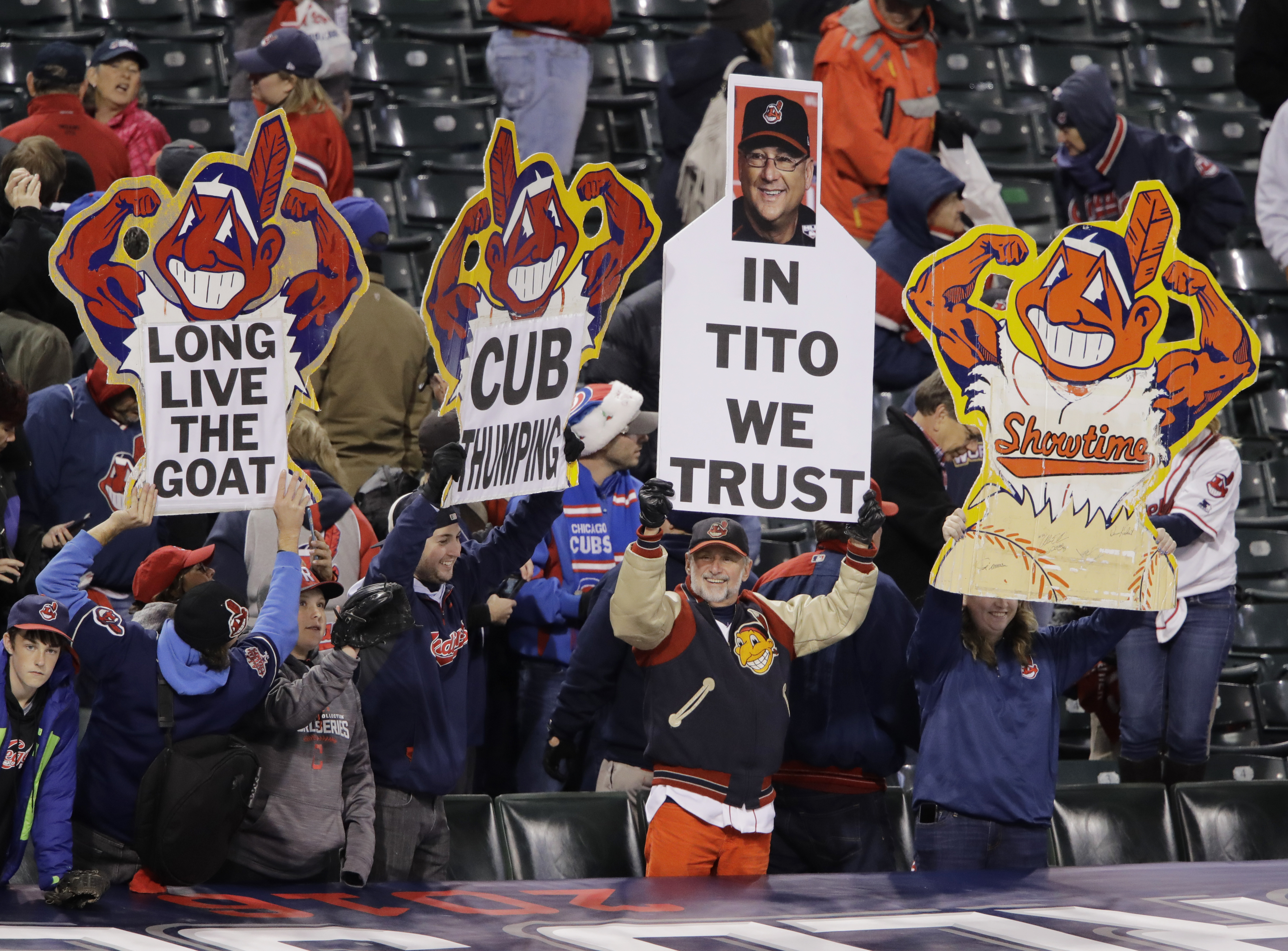 Fans hold up signs after Game 1 of the Major League Baseball World Series between the Cleveland Indians and the Chicago Cubs Tuesday, Oct. 25, 2016, in Cleveland. The Indians won 6-0 to take a 1-0 lead in the series. (AP Photo/Gene J. Puskar)