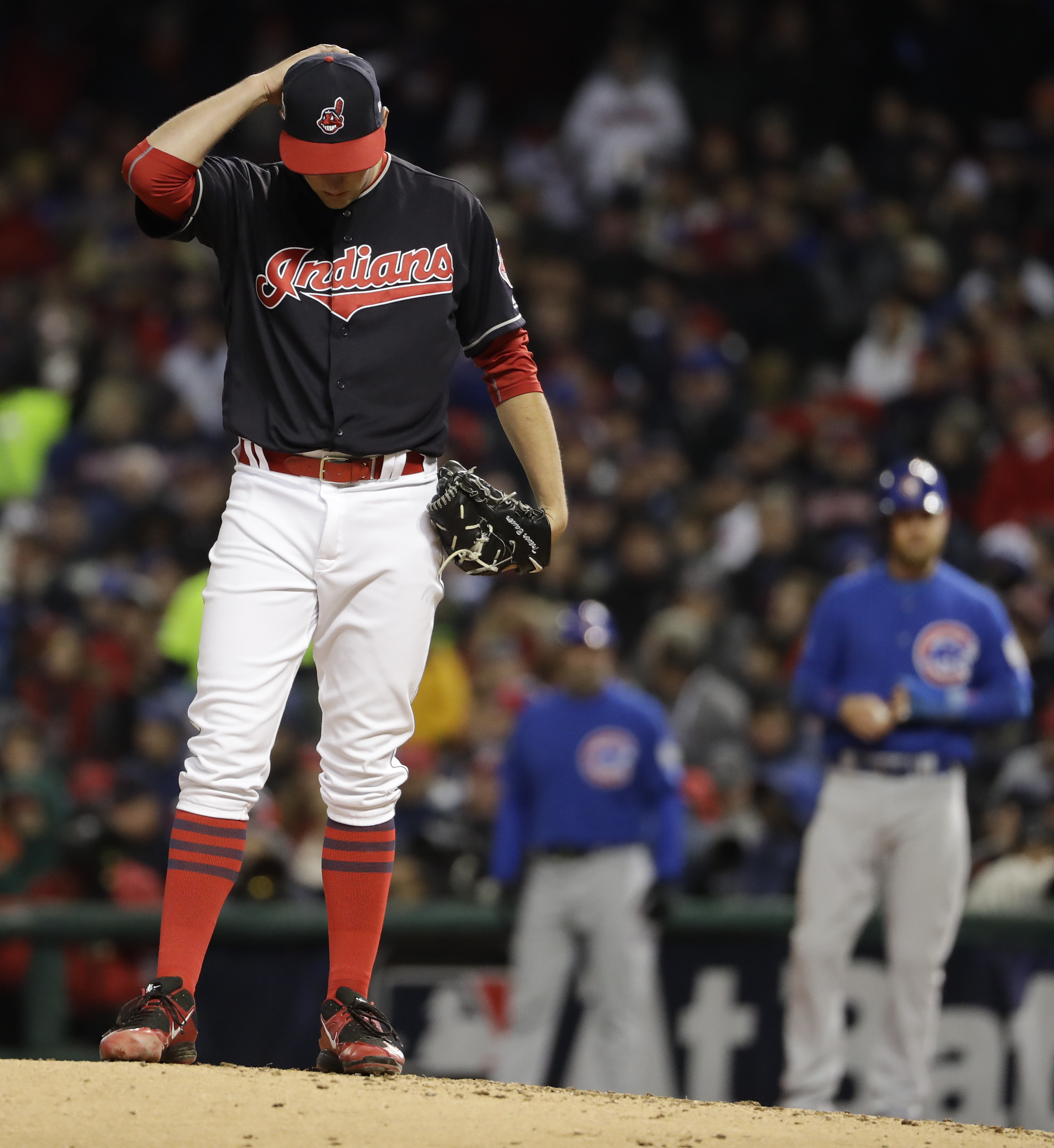 Cleveland Indians starting pitcher Trevor Bauer hangs his head after giving up a hit to the Chicago Cubs during the third inning of Game 2 of the Major League Baseball World Series Wednesday, Oct. 26, 2016, in Cleveland. (AP Photo/Matt Slocum)