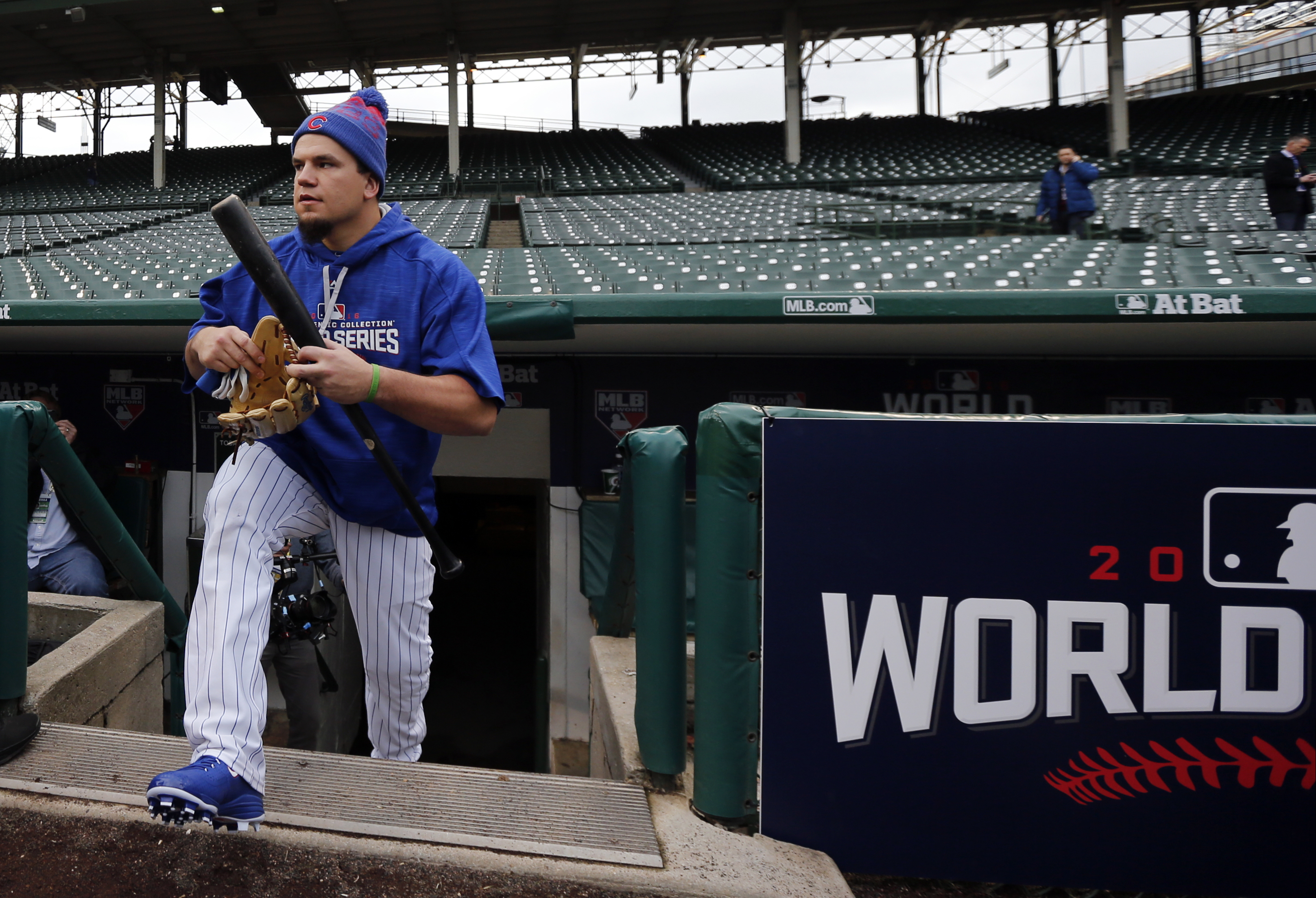 Chicago Cubs' Kyle Schwarber walks out to the field to work out for Friday's Game 3 of the Major League Baseball World Series against the Cleveland Indians, Thursday, Oct. 27, 2016, in Chicago. (AP Photo/Charles Rex Arbogast)