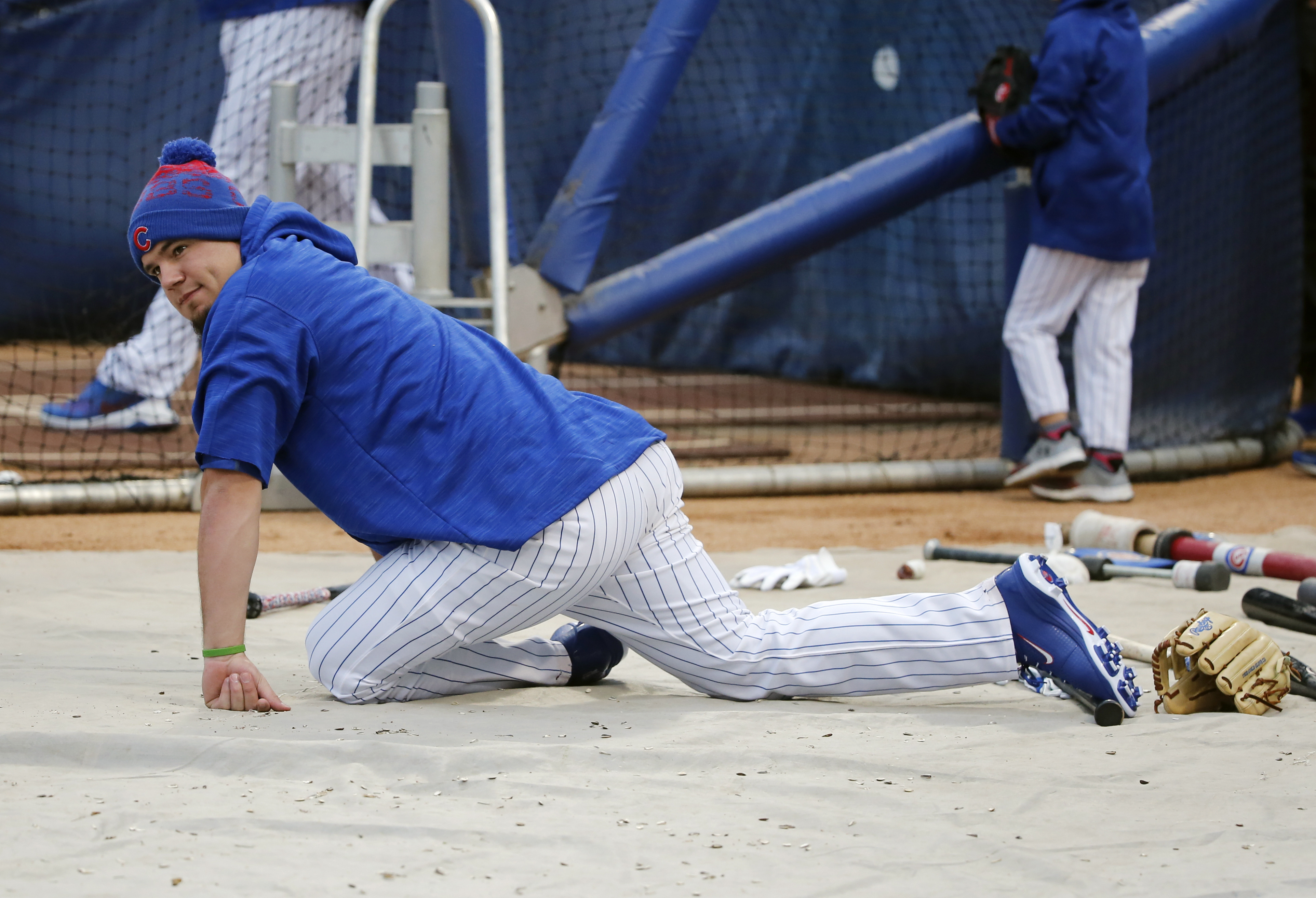 Chicago Cubs' Kyle Schwarber stretches as he works out for Friday's Game 3 of the Major League Baseball World Series against the Cleveland Indians, Thursday, Oct. 27, 2016, in Chicago. (AP Photo/Charles Rex Arbogast)