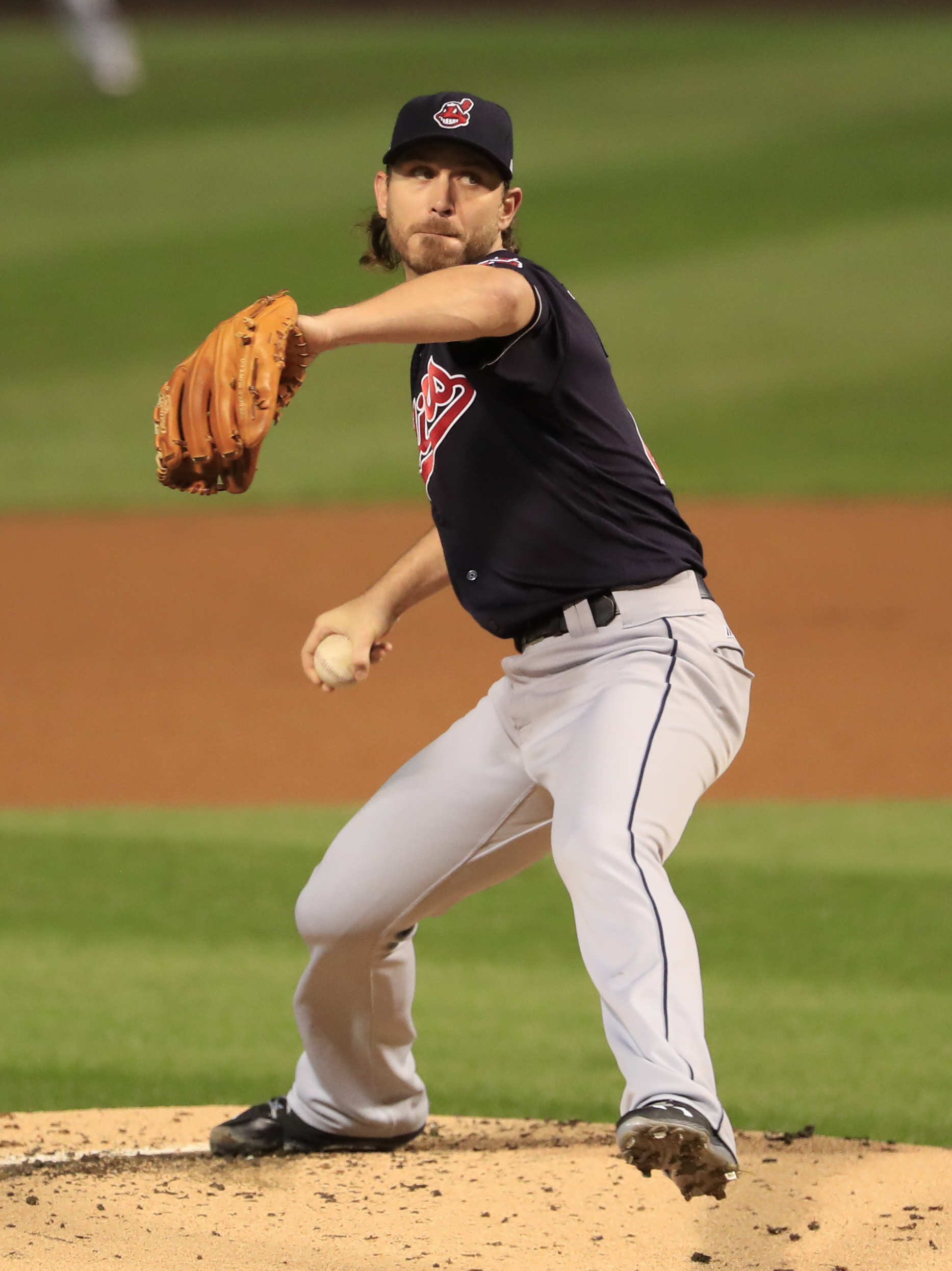 Cleveland Indians starting pitcher Josh Tomlin throws during the first inning of Game 3 of the Major League Baseball World Series against the Chicago Cubs Friday, Oct. 28, 2016, in Chicago. (AP Photo/Tannen Maury, Pool)
