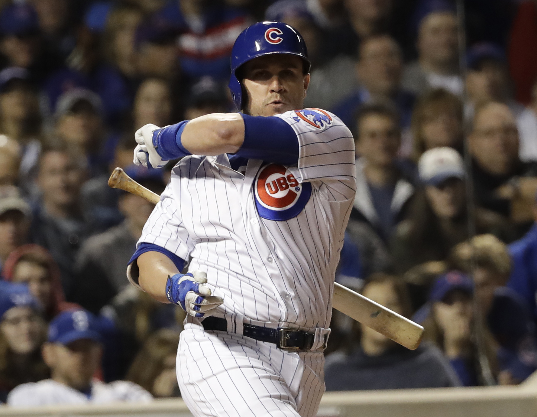 Chicago Cubs' Miguel Montero loses his bat swinging during the fifth inning of Game 3 of the Major League Baseball World Series against the Cleveland Indians Friday, Oct. 28, 2016, in Chicago. (AP Photo/David J. Phillip)