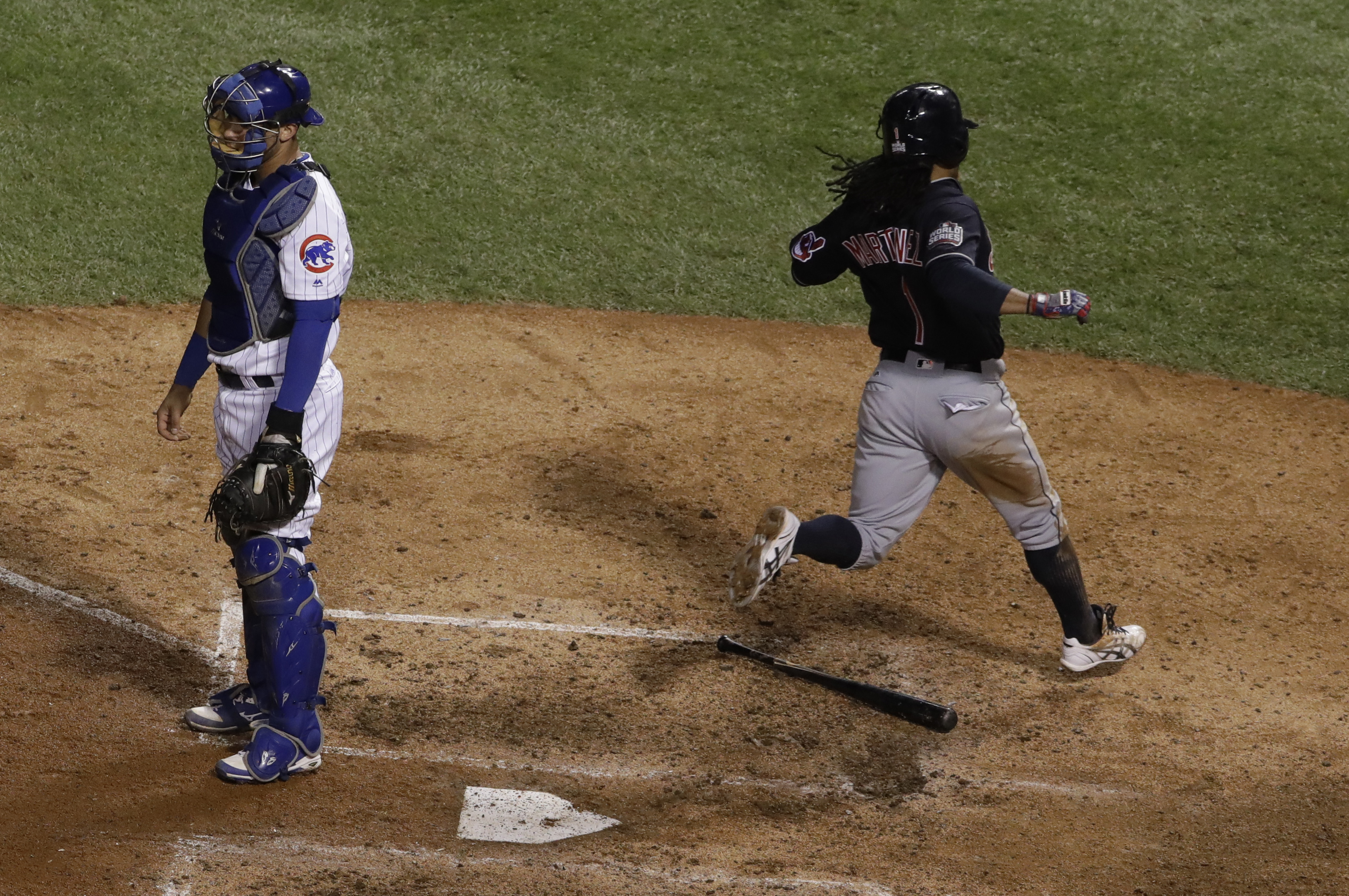Cleveland Indians' Michael Martinez scores past Chicago Cubs catcher Willson Contreras during the seventh inning of Game 3 of the Major League Baseball World Series Friday, Oct. 28, 2016, in Chicago. Martinez scored from third on a hit by Coco Crisp. (AP