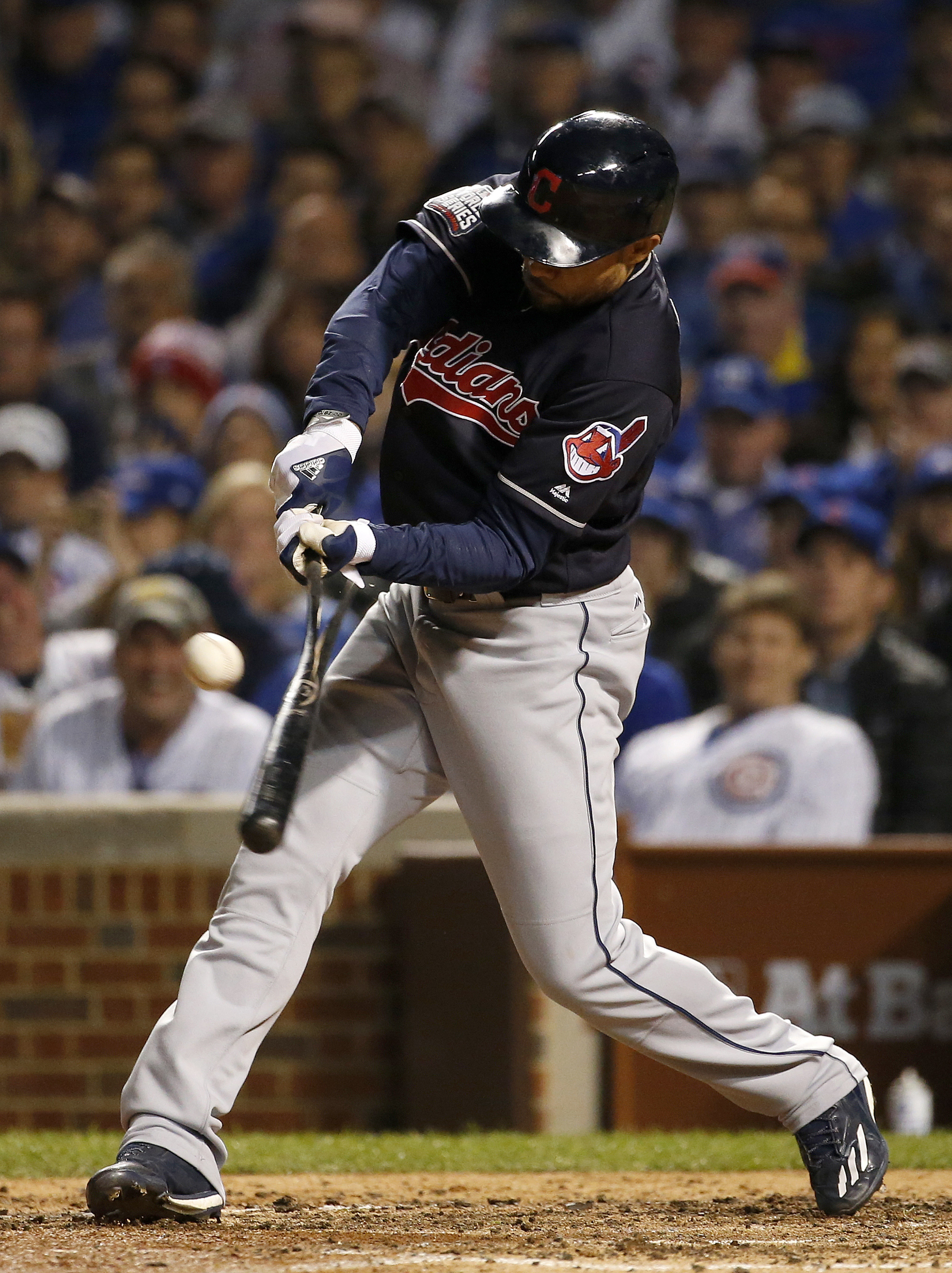 Cleveland Indians' Coco Crisp hits a RBI single during the seventh inning of Game 3 of the Major League Baseball World Series against the Chicago Cubs, Friday, Oct. 28, 2016, in Chicago. (AP Photo/Nam Y. Huh)