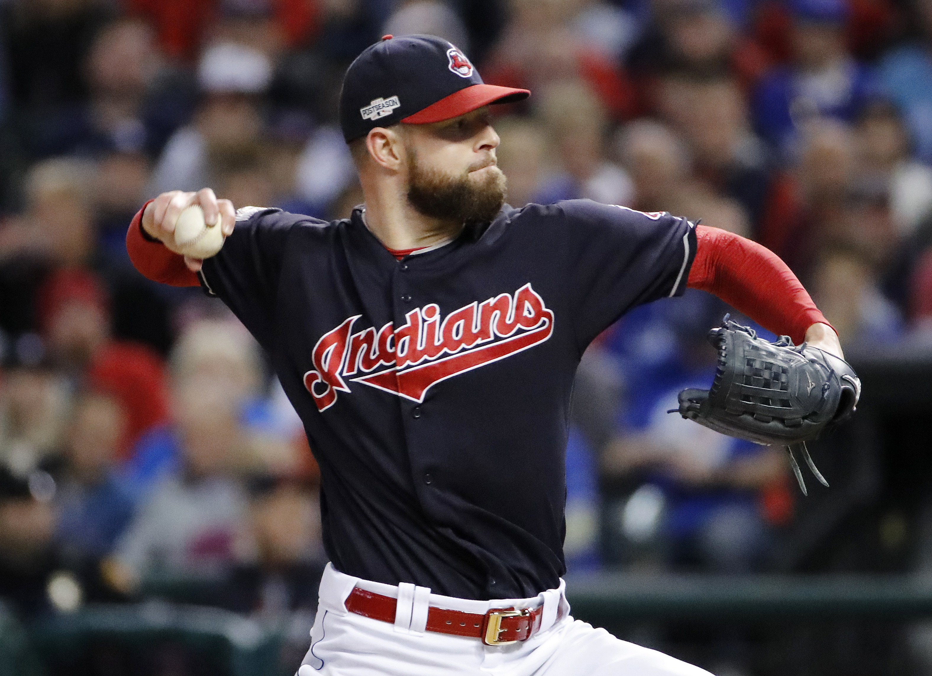 FILE - In this Oct. 14, 2016, file photo, Cleveland Indians starting pitcher Corey Kluber throws against the Toronto Blue Jays during Game 1 of baseball's American League Championship Series in Cleveland. Kluber, who confounded Chicagos hitters in Game 1