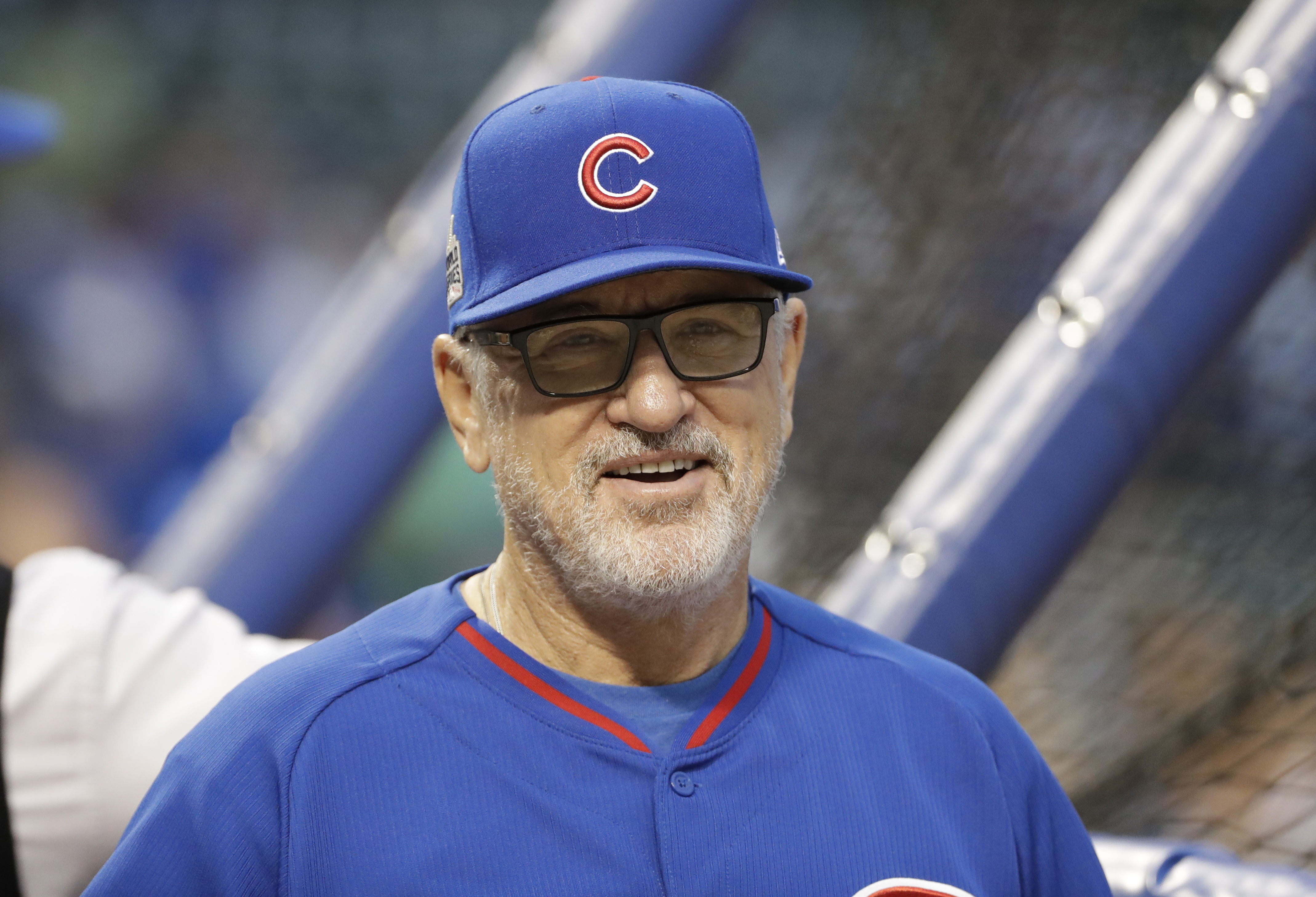 Chicago Cubs manager Joe Maddon smiles before Game 4 of the Major League Baseball World Series against the Cleveland Indians Saturday, Oct. 29, 2016, in Chicago. (AP Photo/David J. Phillip)