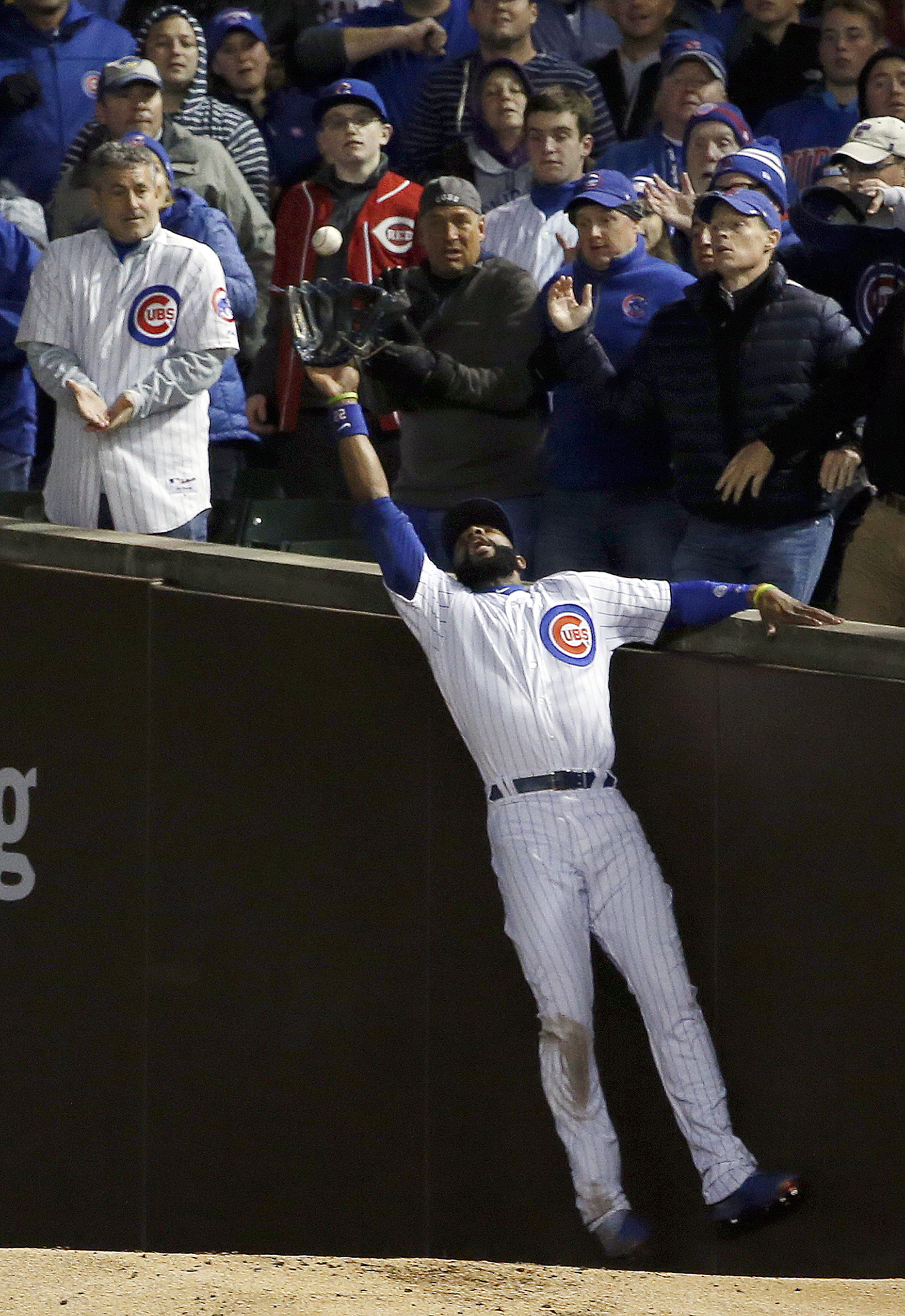 Chicago Cubs right fielder Jason Heyward catches a foul ball hit by Cleveland Indians' Trevor Bauer during the third inning of Game 5 of the Major League Baseball World Series Sunday, Oct. 30, 2016, in Chicago. (AP Photo/Nam Y. Huh)