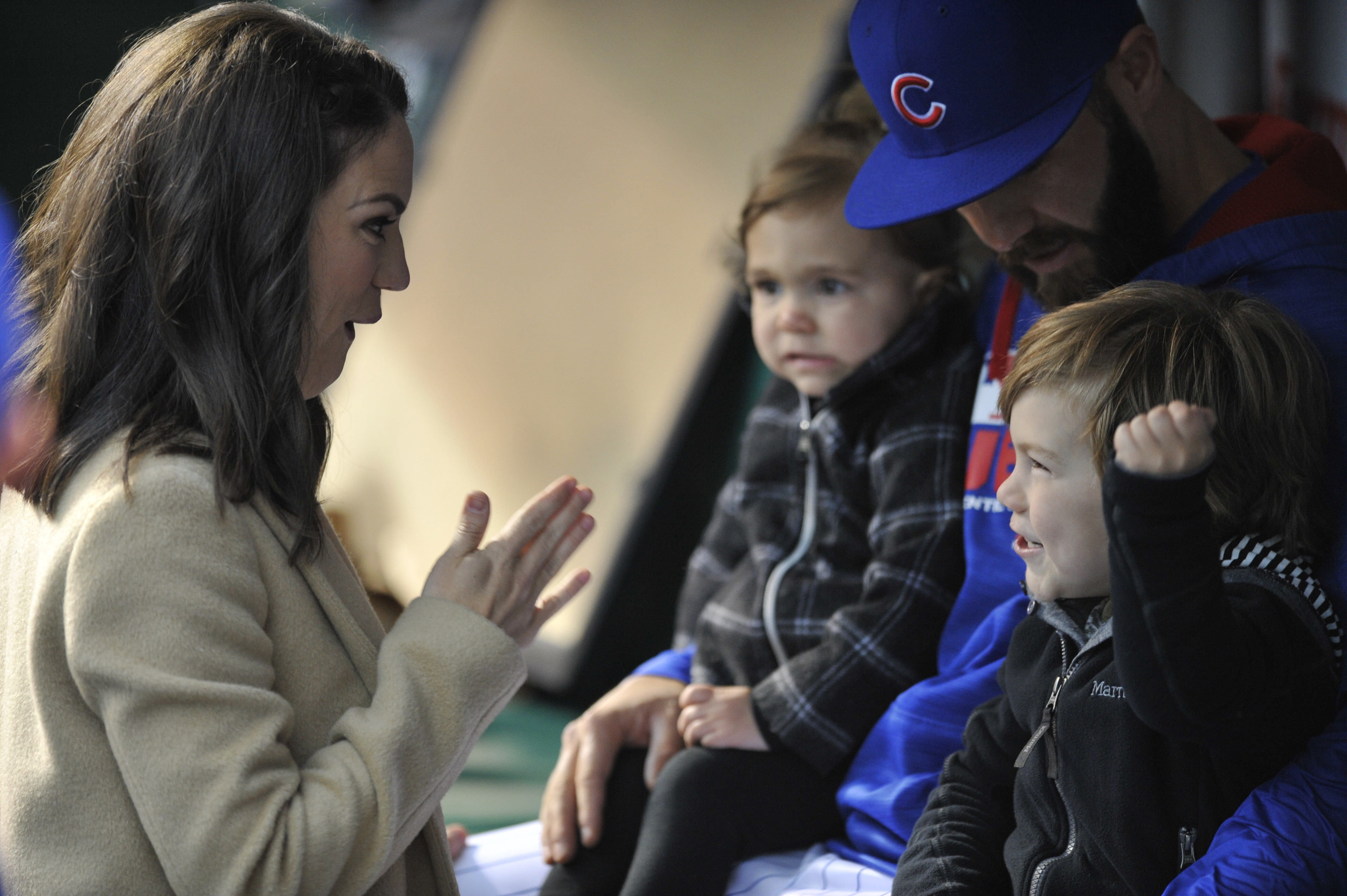 FILE - In this April 26, 2016, file photo, Chicago Cubs pitcher Jake Arrieta, wife Brittany, daughter, Palmer, and son, Cooper, wait in a dugout before a ceremony honoring Arrieta before the Cubs' baseball game against the Milwaukee Brewers in Chicago. Br