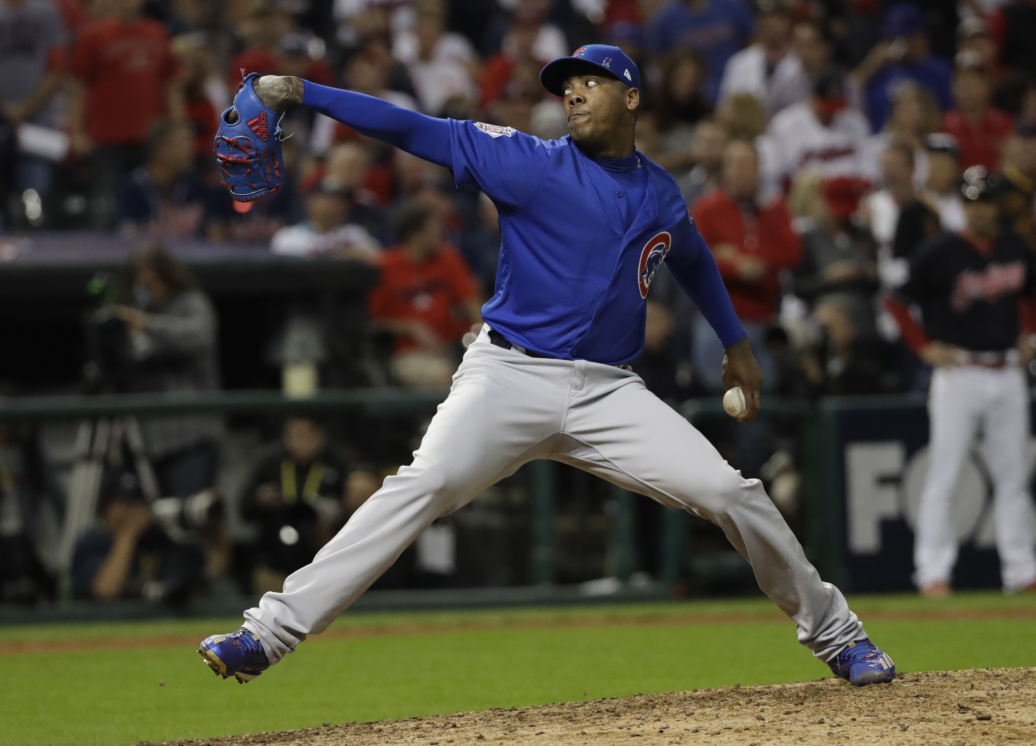 Chicago Cubs relief pitcher Aroldis Chapman throws during the eighth inning of Game 6 of the Major League Baseball World Series against the Cleveland Indians Tuesday, Nov. 1, 2016, in Cleveland. (AP Photo/David J. Phillip)