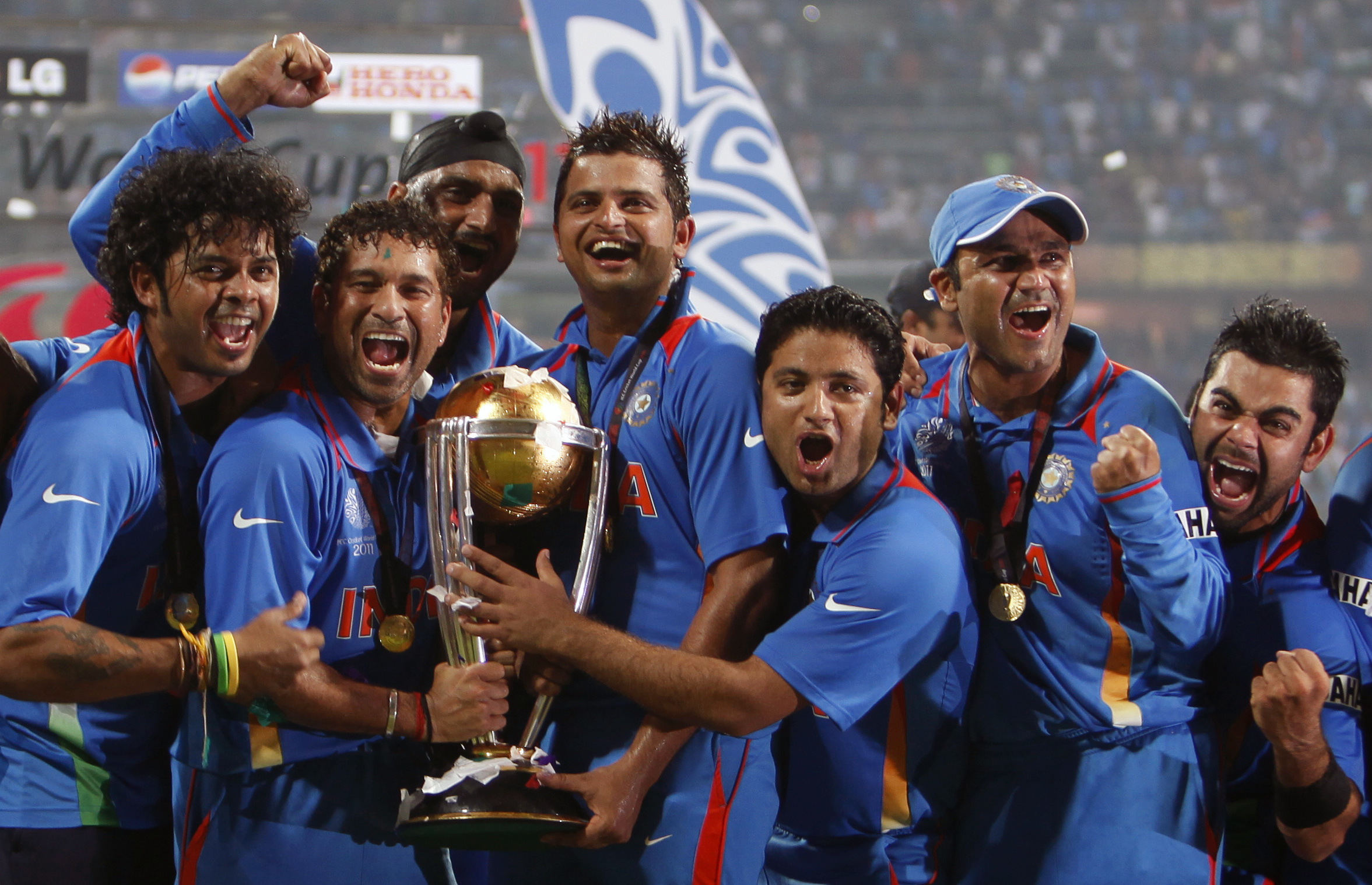 FILE - In this Saturday, April 2 , 2011 file photo, India's players celebrate their win with the trophy after the Cricket World Cup final match against Sri Lanka in Mumbai, India. The shock 1983 Cricket World Cup triumph boosted the sport's appeal in Indi