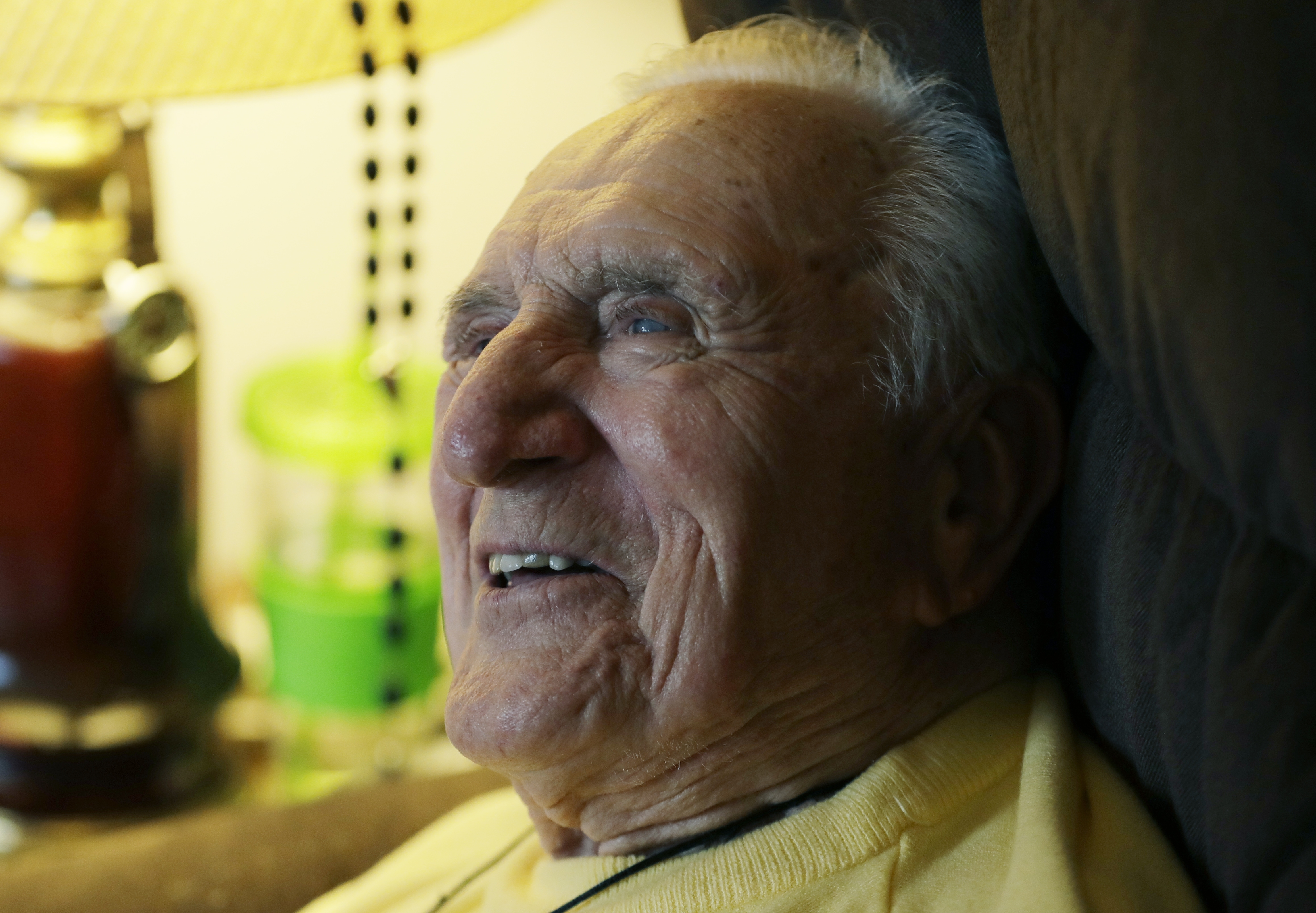 Ed Mierkowicz, the one player still alive who appeared in the 1945 World Series, when the Chicago Cubs reached Game 7 before losing to Detroit is interviewed in his home, Wednesday, Nov. 2, 2016, in Rochester Hills, Mich. (AP Photo/Carlos Osorio)