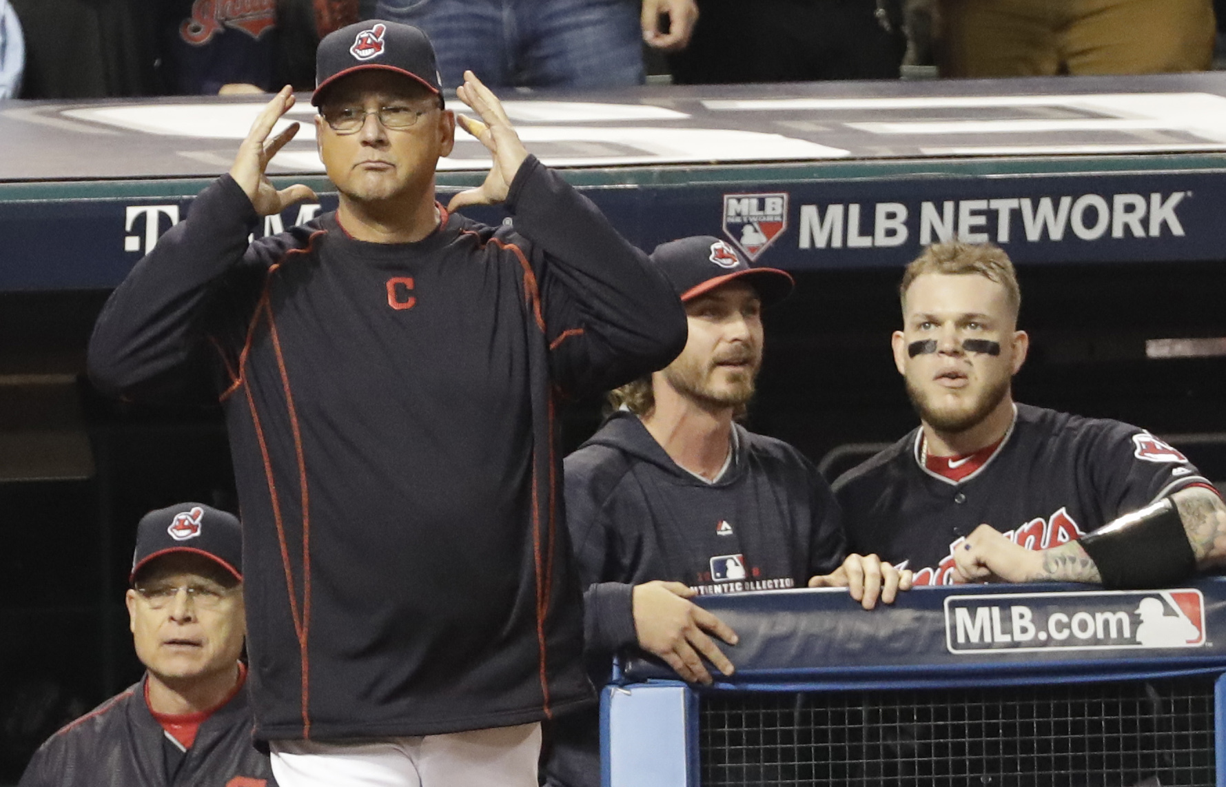 Cleveland Indians manager Terry Francona requests an instant replay during the third inning of Game 7 of the Major League Baseball World Series against the Chicago Cubs Wednesday, Nov. 2, 2016, in Cleveland. (AP Photo/David J. Phillip)
