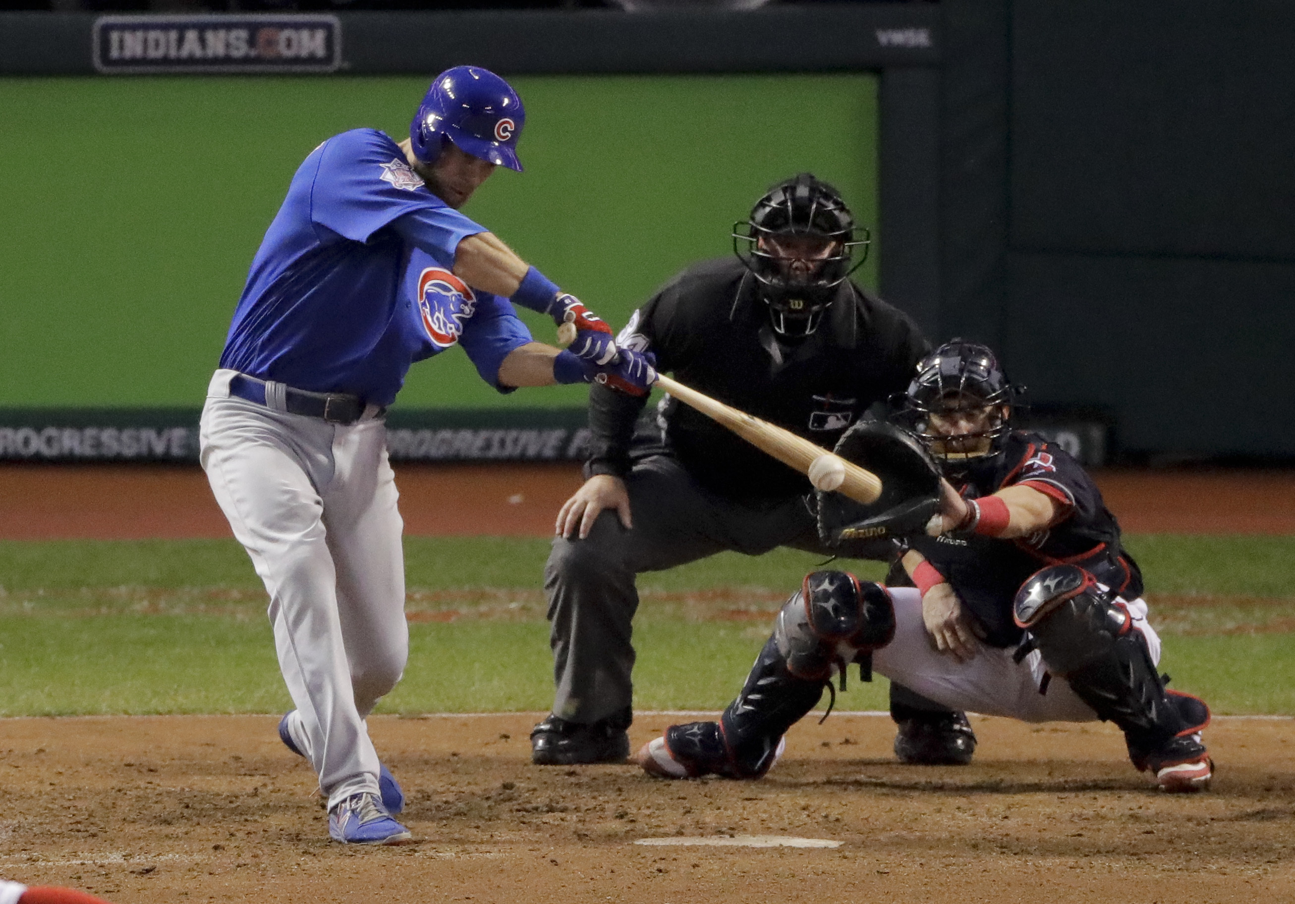 Chicago Cubs' Ben Zobrist watches his RBI-double against the Cleveland Indians during the 10th inning of Game 7 of the Major League Baseball World Series Thursday, Nov. 3, 2016, in Cleveland. (AP Photo/Charlie Riedel)