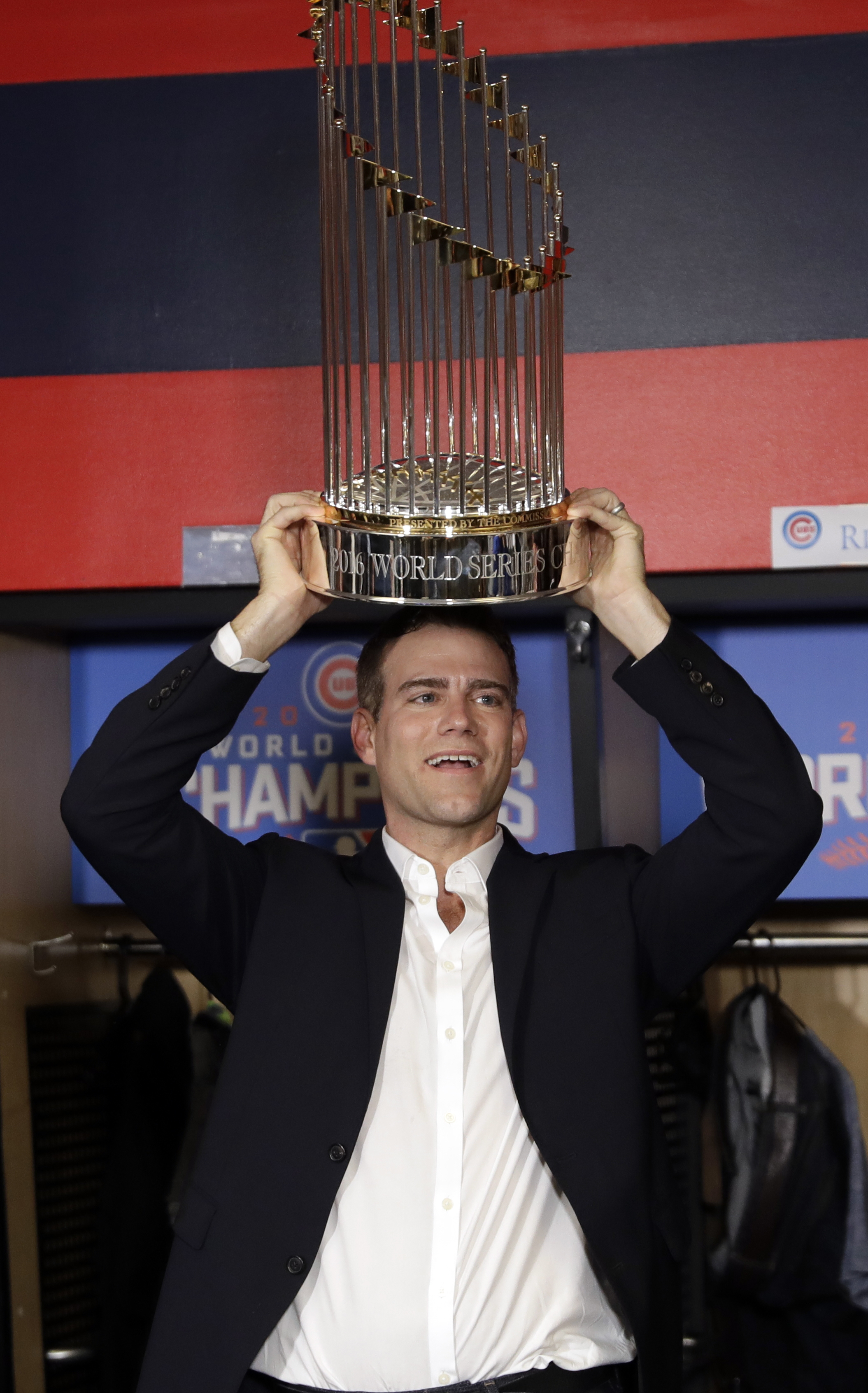 Chicago Cubs president for baseball operations Theo Epstein celebrates after Game 7 of the Major League Baseball World Series Thursday, Nov. 3, 2016, in Cleveland. The Cubs won 8-7 in 10 innings to win the series 4-3. (AP Photo/David J. Phillip)