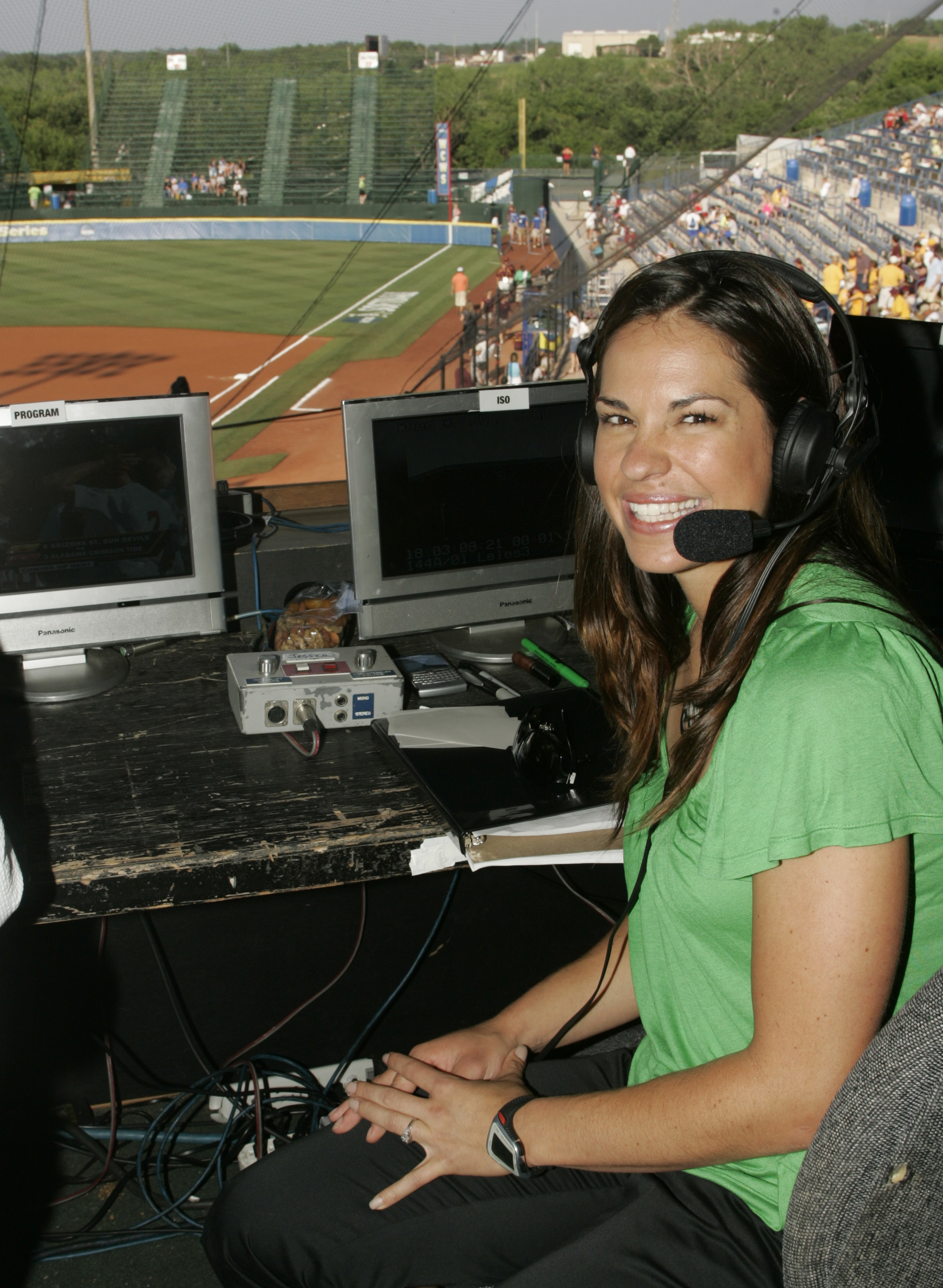 FILE - In this May 29, 2009 file photo, USA softball player Jessica Mendoza poses for a photo in the ESPN broadcast booth at the Women's College World Series in Oklahoma City.  Mendoza chatted up Kyle Schwarber, broke down pitcher's tendencies and dealt w