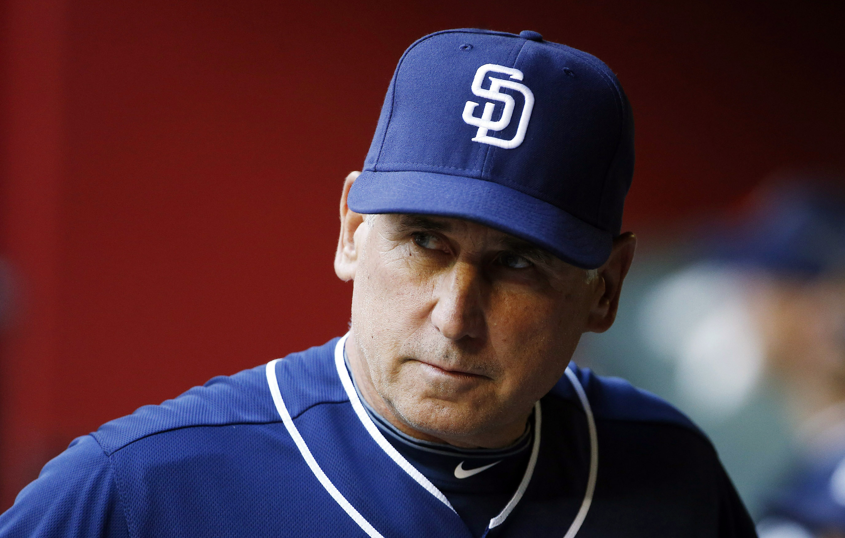 FILE - In this May 8, 2015, file photo, San Diego Padres' Bud Black paces in the dugout prior to a baseball game against the Arizona Diamondbacks in Phoenix. A person with knowledge of the situation tells The Associated Press that Bud Black has been hired