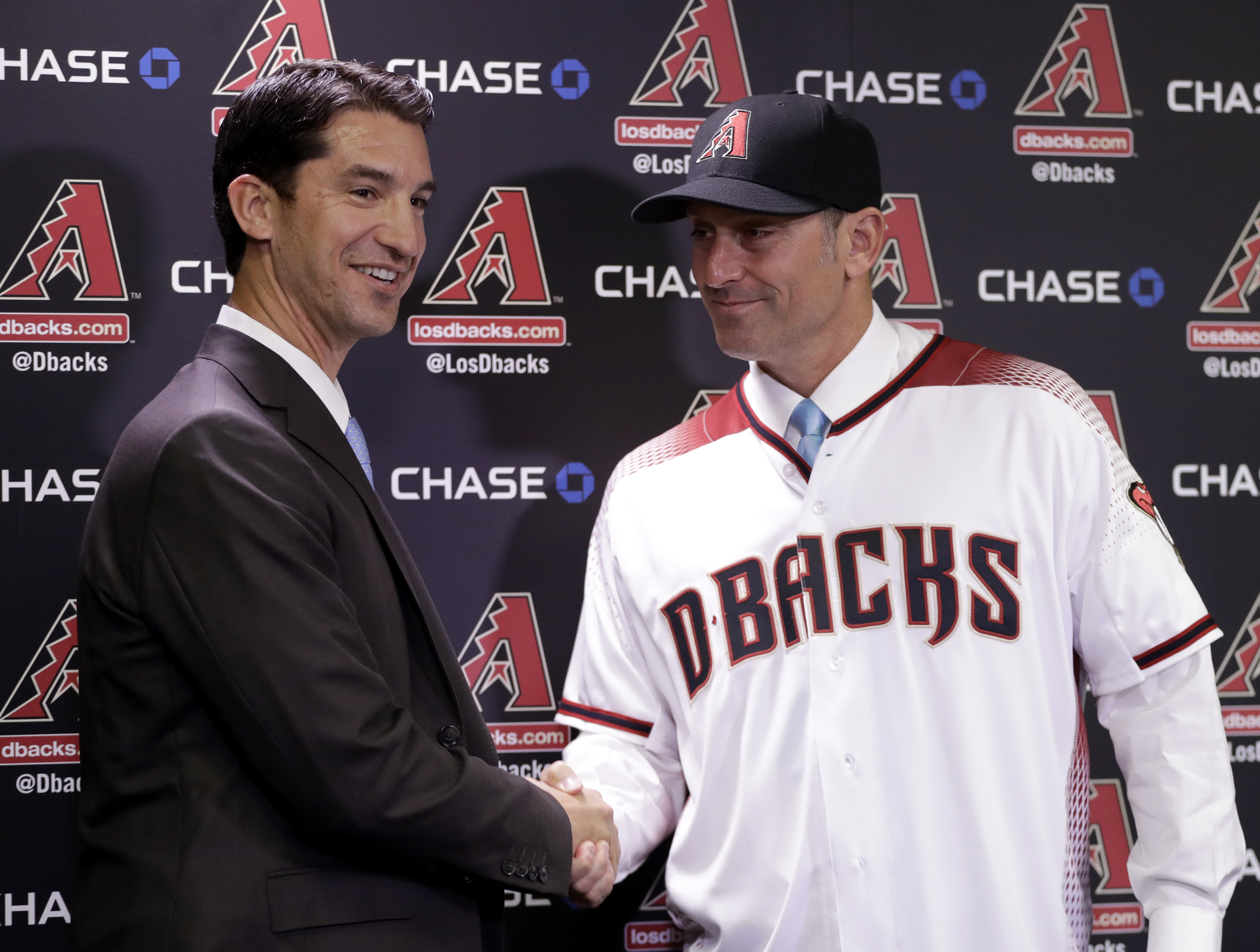 New Arizona Diamondbacks manager Torey Lovullo, right, is greeted by Diamondbacks' Executive Vice President and General Manager Mike Hazenor during an introductory press conference Monday, Nov. 7, 2016, at Chase Field in Phoenix. (AP Photo/Matt York)