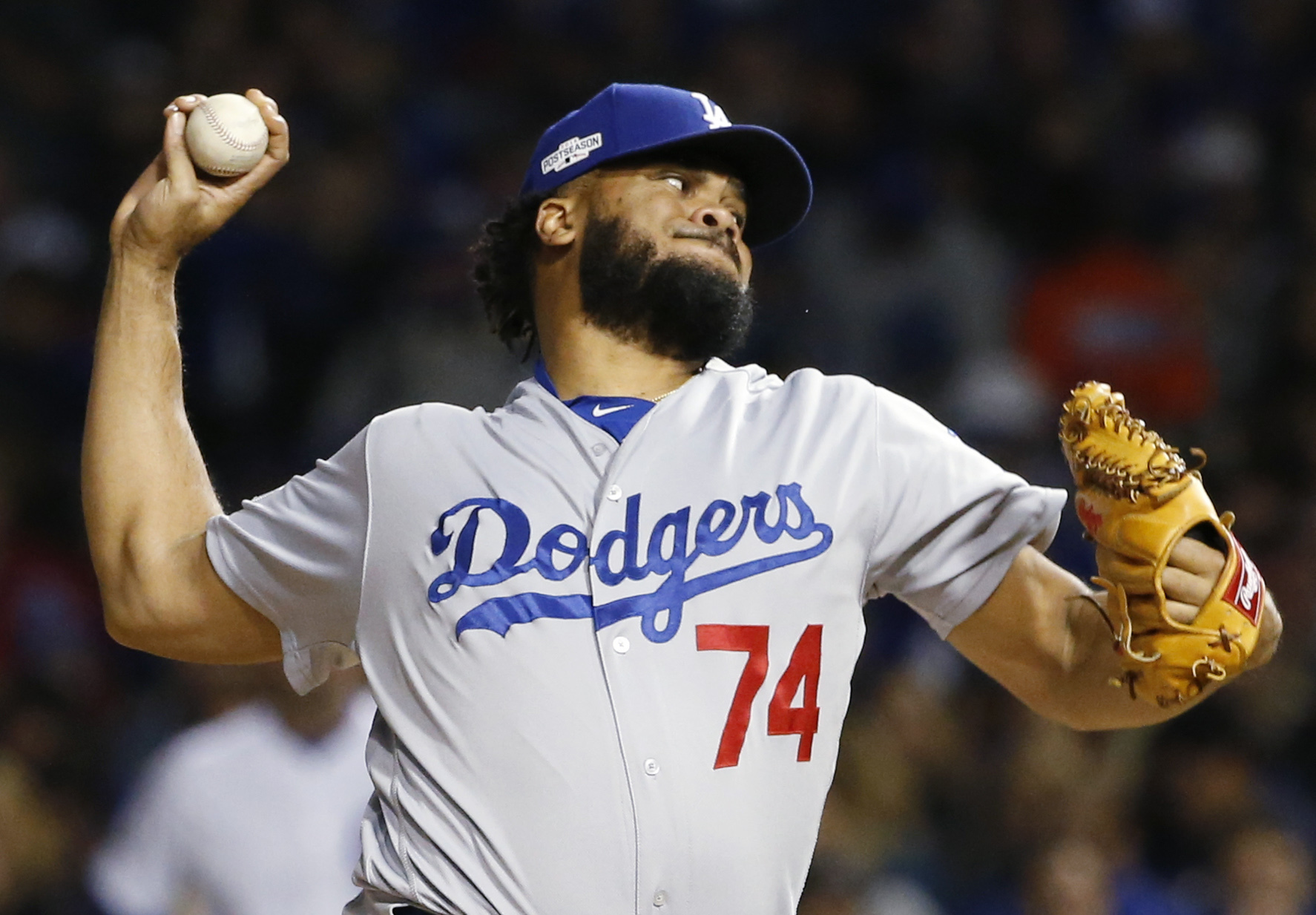 FILE - In this Oct. 22, 2016, file photo, Los Angeles Dodgers relief pitcher Kenley Jansen (74) throws during the sixth inning of Game 6 of the National League baseball championship series against the Chicago Cubs, in Chicago. The Dodgers have extended $1
