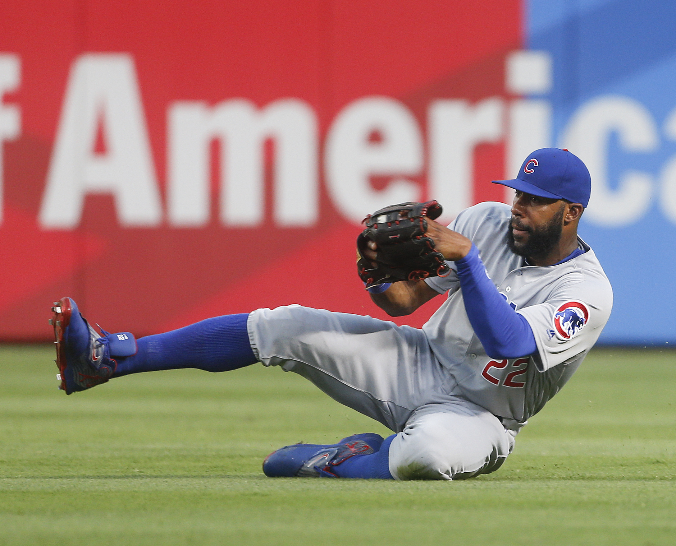 FILE - In this June 10, 2016, file photo, Chicago Cubs right fielder Jason Heyward makes a sliding catch on a fly ball by Atlanta Braves' Nick Markakis during the third inning of a baseball game Friday, June 10, 2016, in Atlanta. Heyward and Cubs first ba