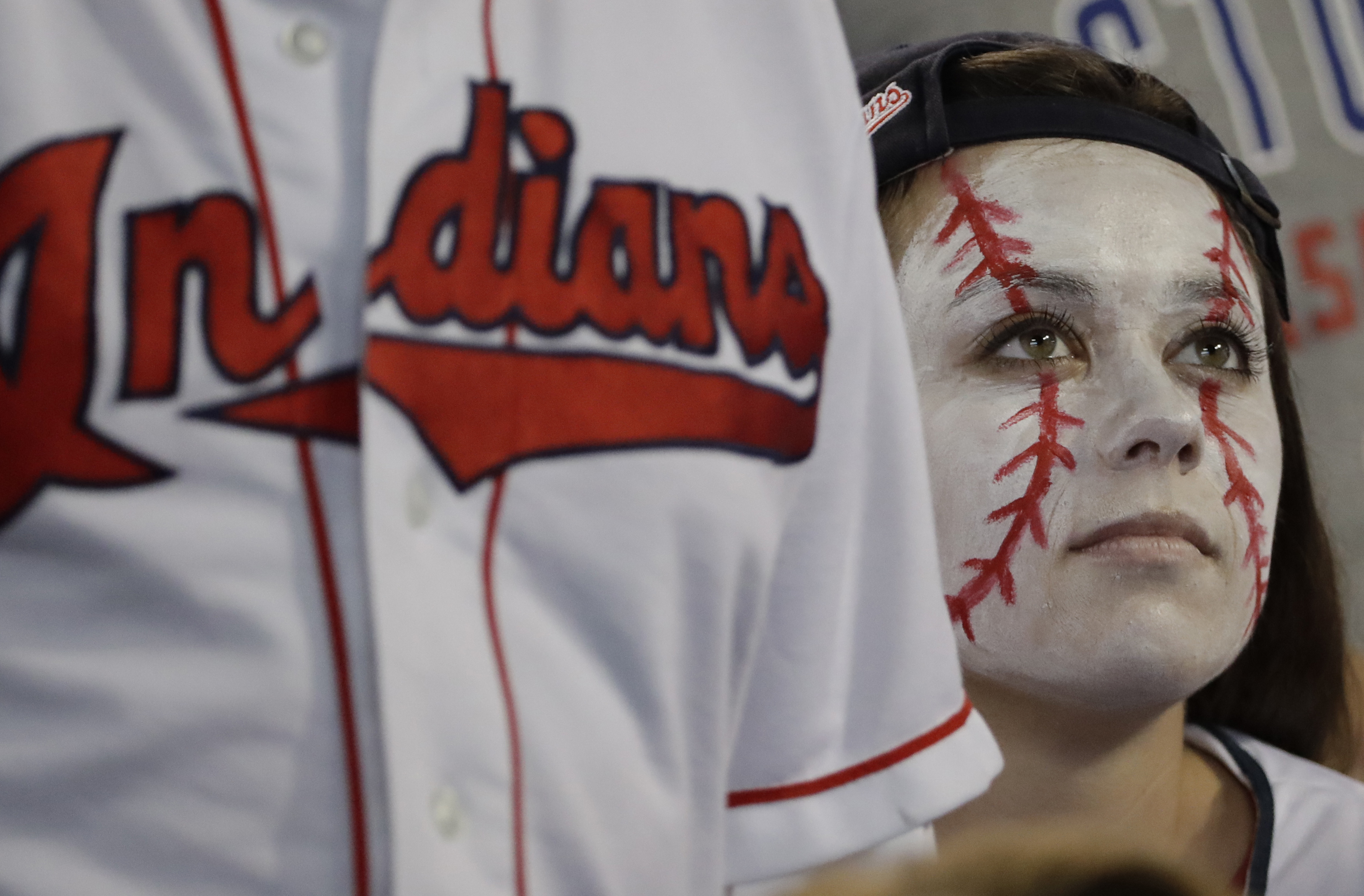 FILE - In this Nov. 1, 2016, file photo, a Cleveland Indians fan reacts during the sixth inning of Game 6 of the Major League Baseball World Series against the Chicago Cubs in Cleveland. The Indians went on to lose the Series in seven games. ESPN and The