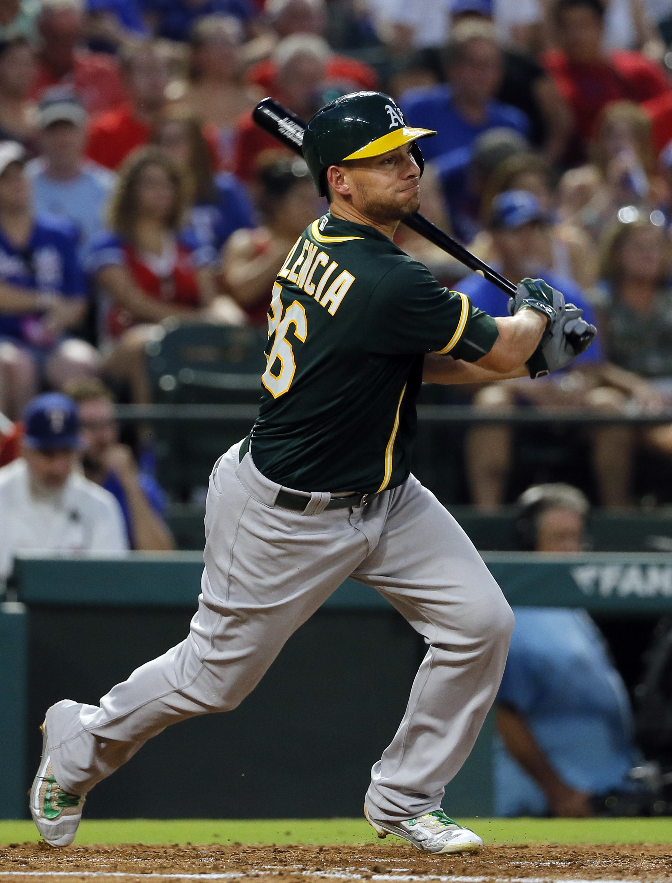Oakland Athletics' Danny Valencia follows through on a single off a pitch from Texas Rangers' Yu Darvish in the second inning of a baseball game, Saturday, Sept. 17, 2016, in Arlington, Texas. (AP Photo/Tony Gutierrez)